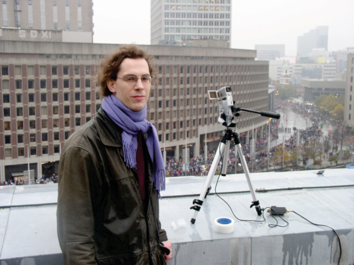 NECSI Researcher Richard Metzler captures the crowds from atop City Hall