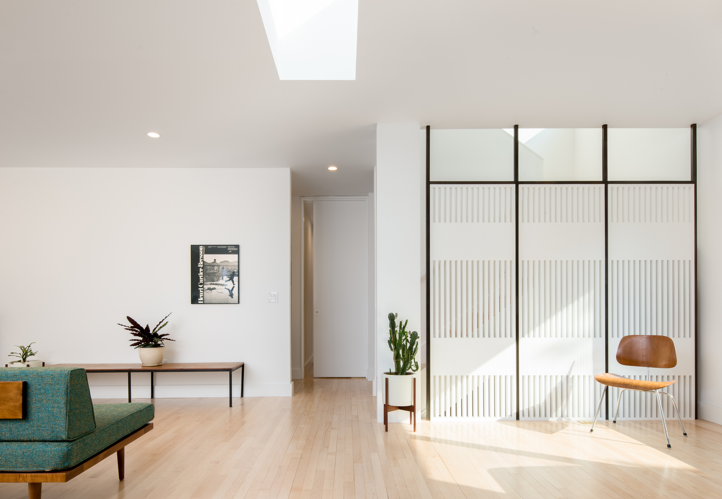 Mid-century home remodel with custom wood screen wall in Minneapolis