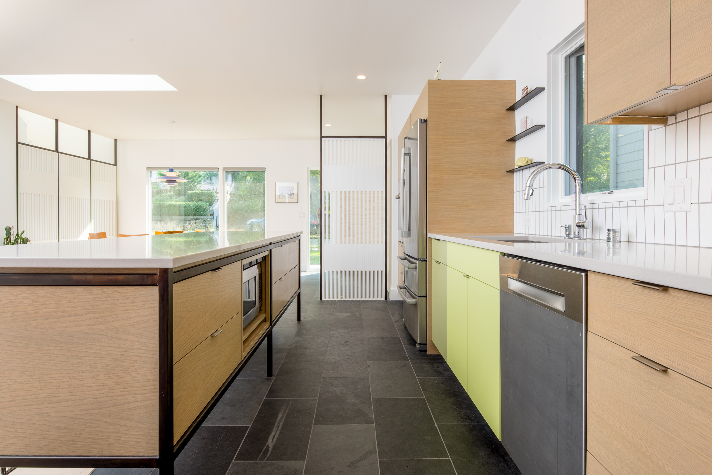 Custom midcentury kitchen with colorful cabinetry and steel accents