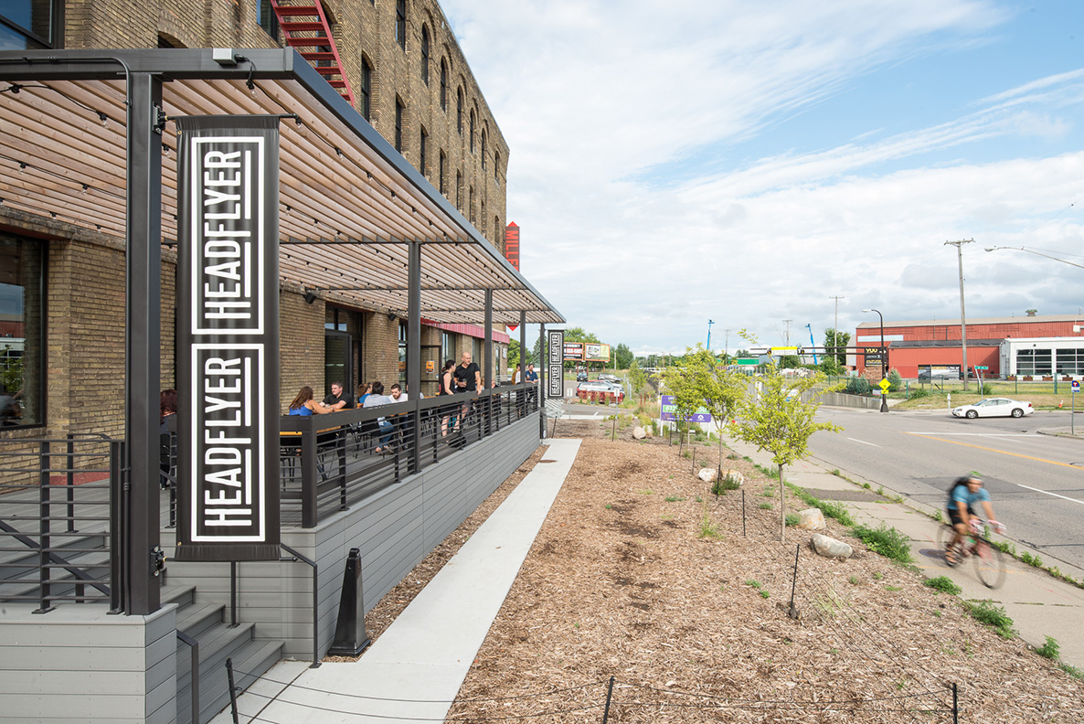 Cali Bamboo patio with custom steel and wood pergola at brewery in Minneapolis.