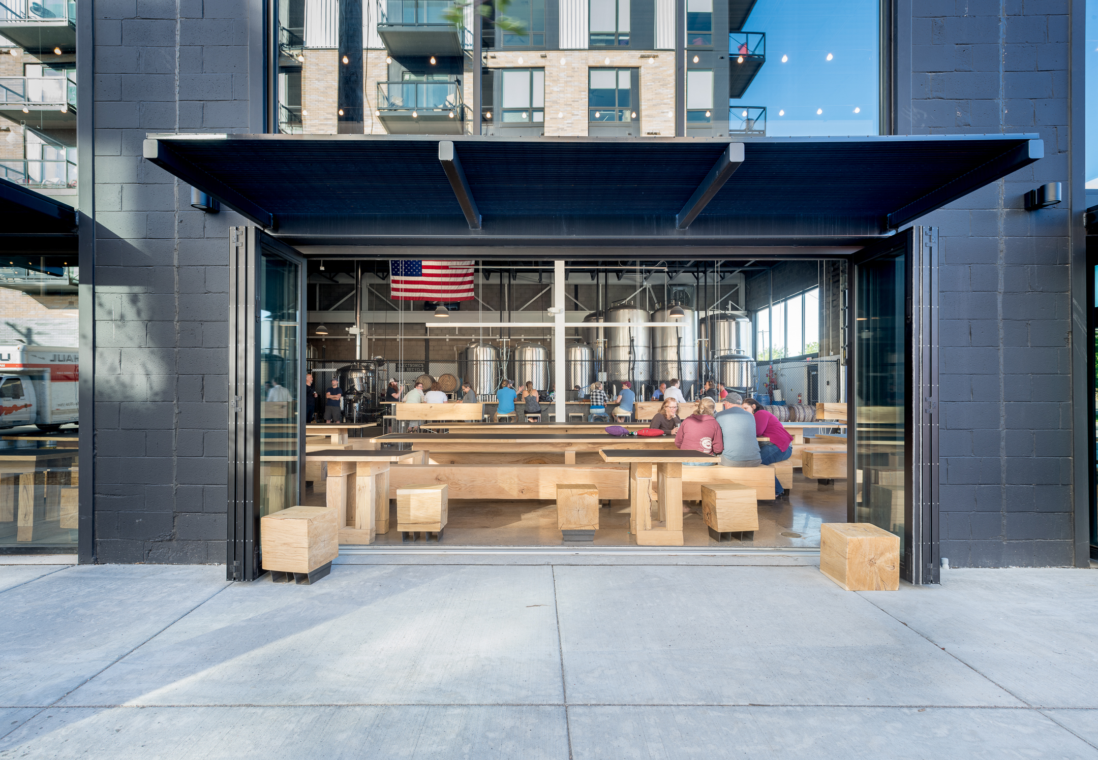 Open air seating area in brewery remodel by Christian Dean Architecture.