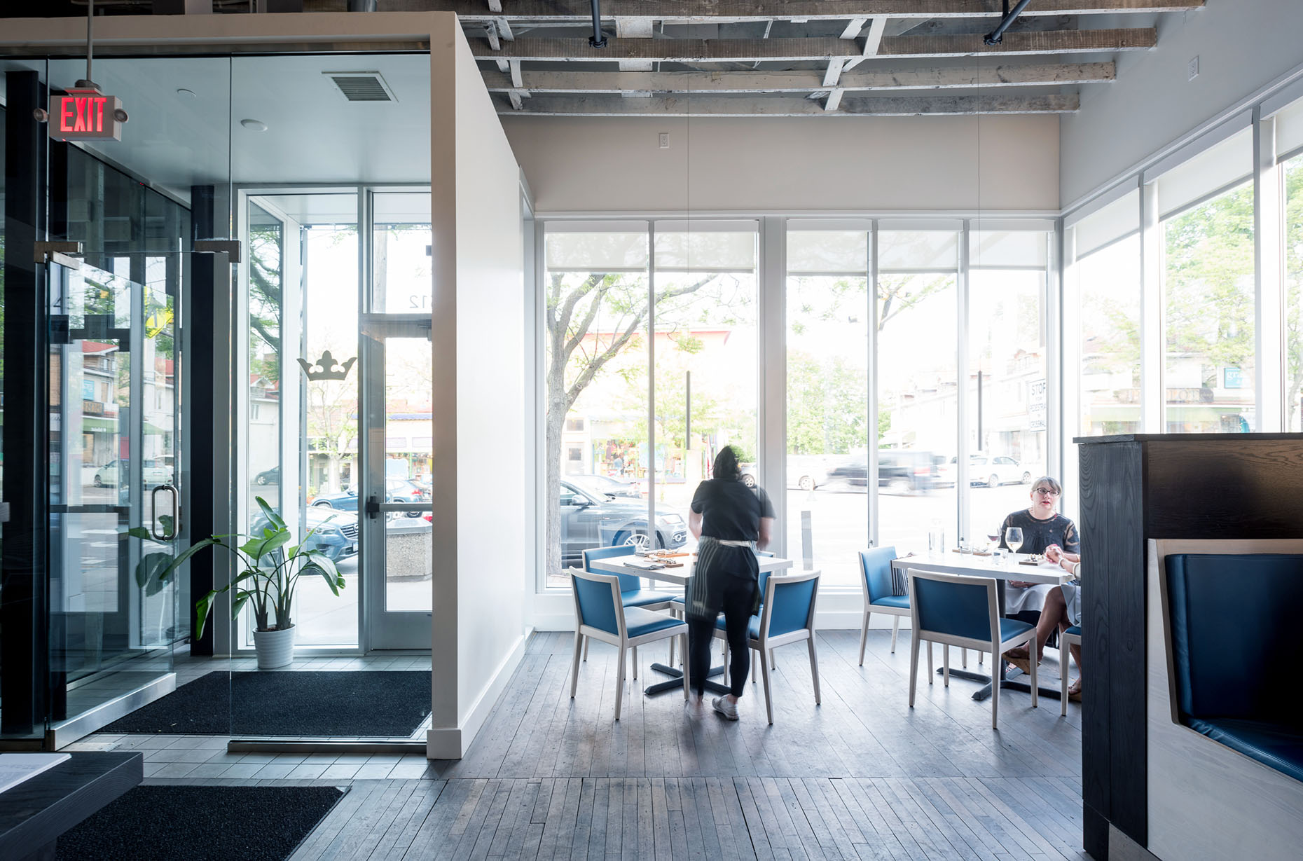 light filled entry and dining area in modern restaurant in minneapolis by christian dean architecture