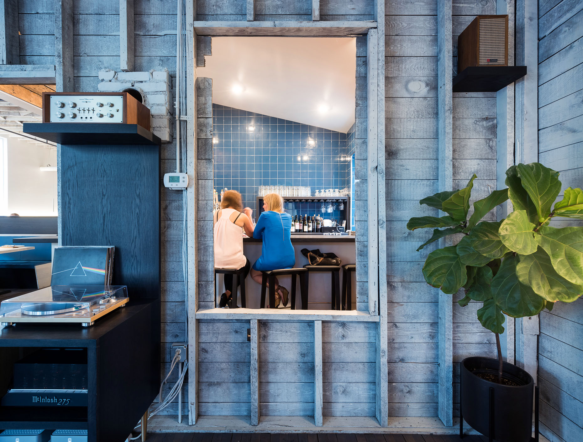 white washed exposed wood framing in modern restaurant remodel in minneapolis