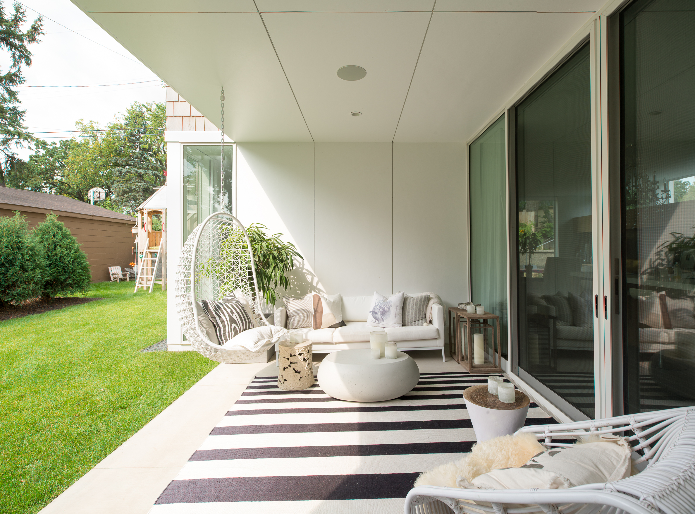 Covered outdoor patio on a modern beach home in Minneapolis