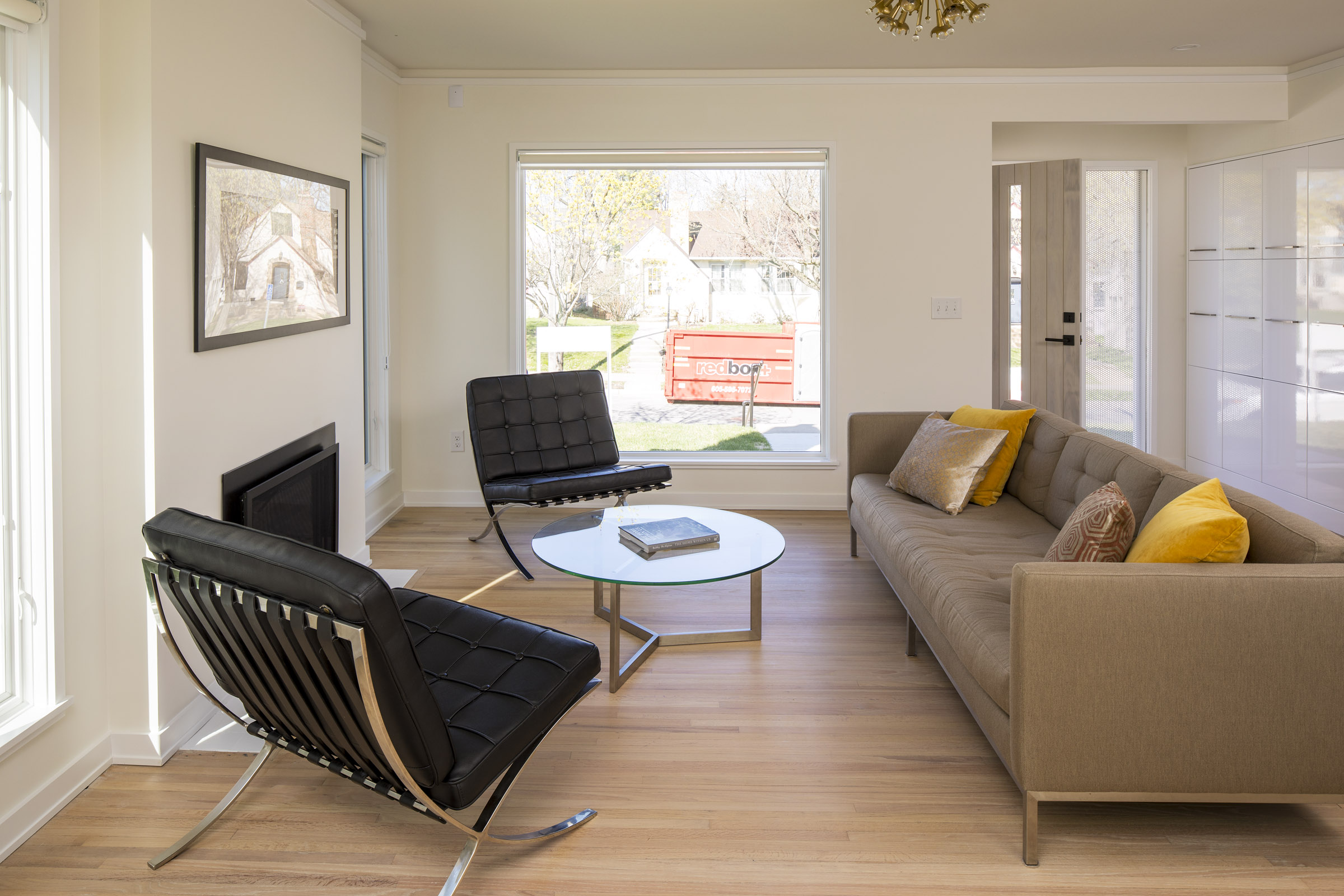 Modern living room remodel with wood floor and large windows