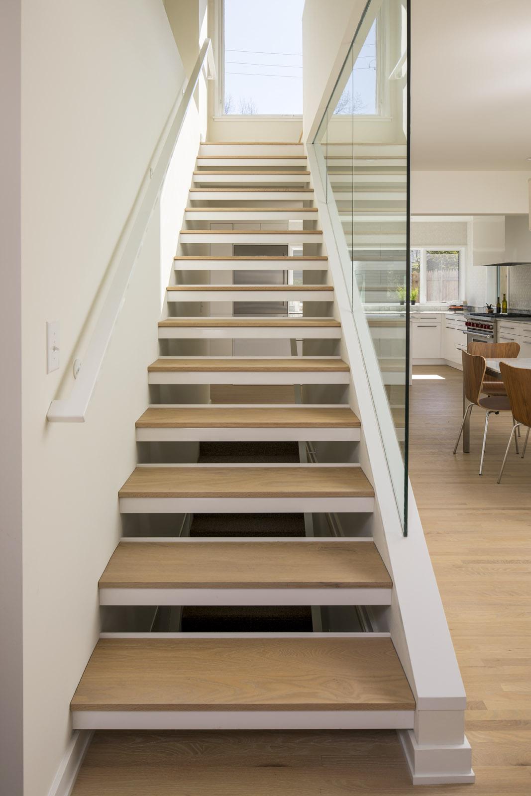 Custom open wood stair tread detail in modern home