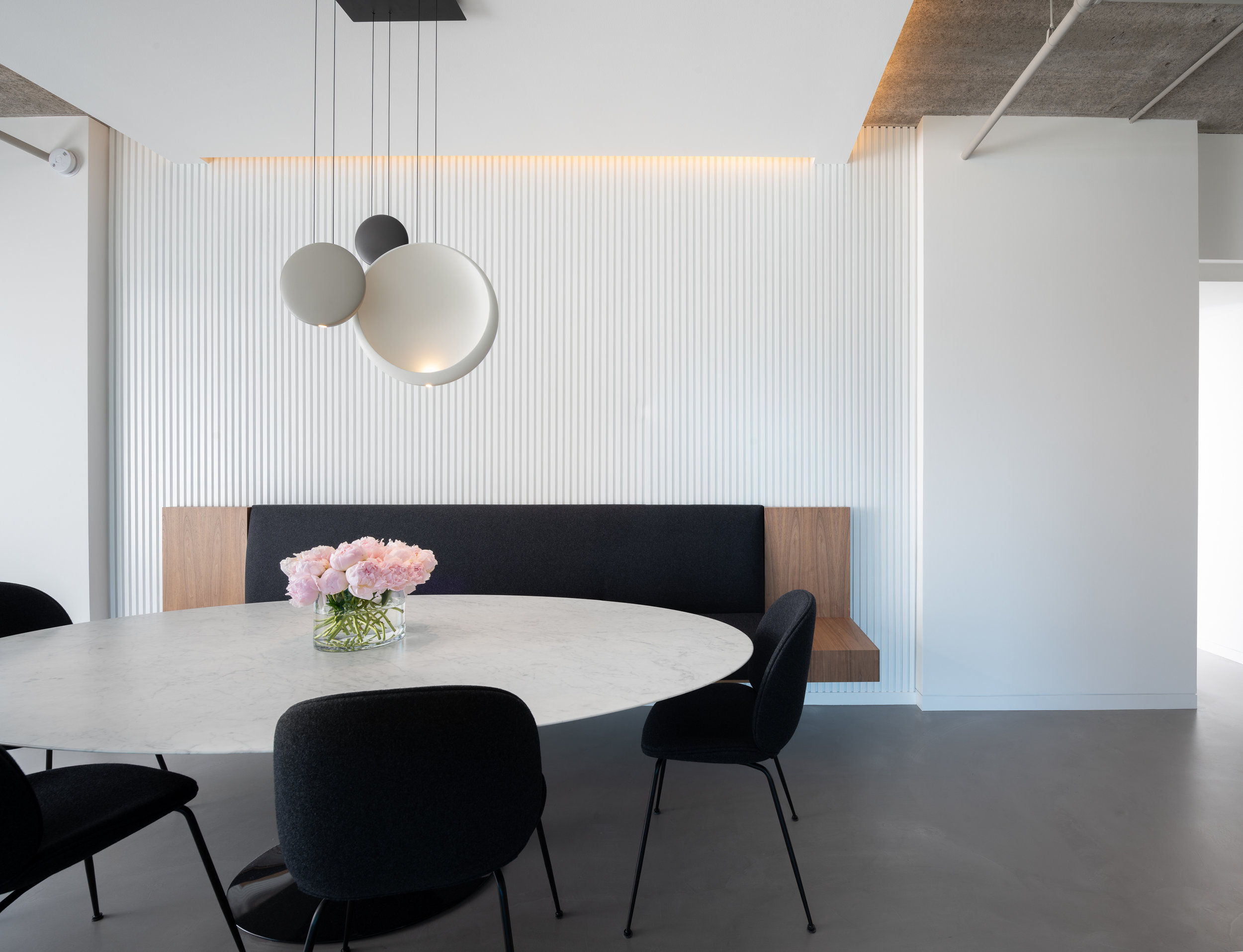Modern dining room with custom upholstered floating bench designed by Christian Dean Architecture