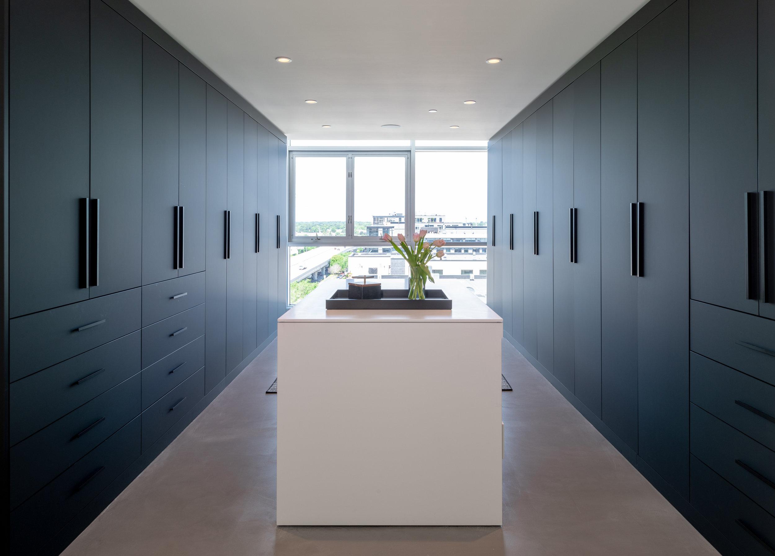 Custom monochrome closet cabinetry
