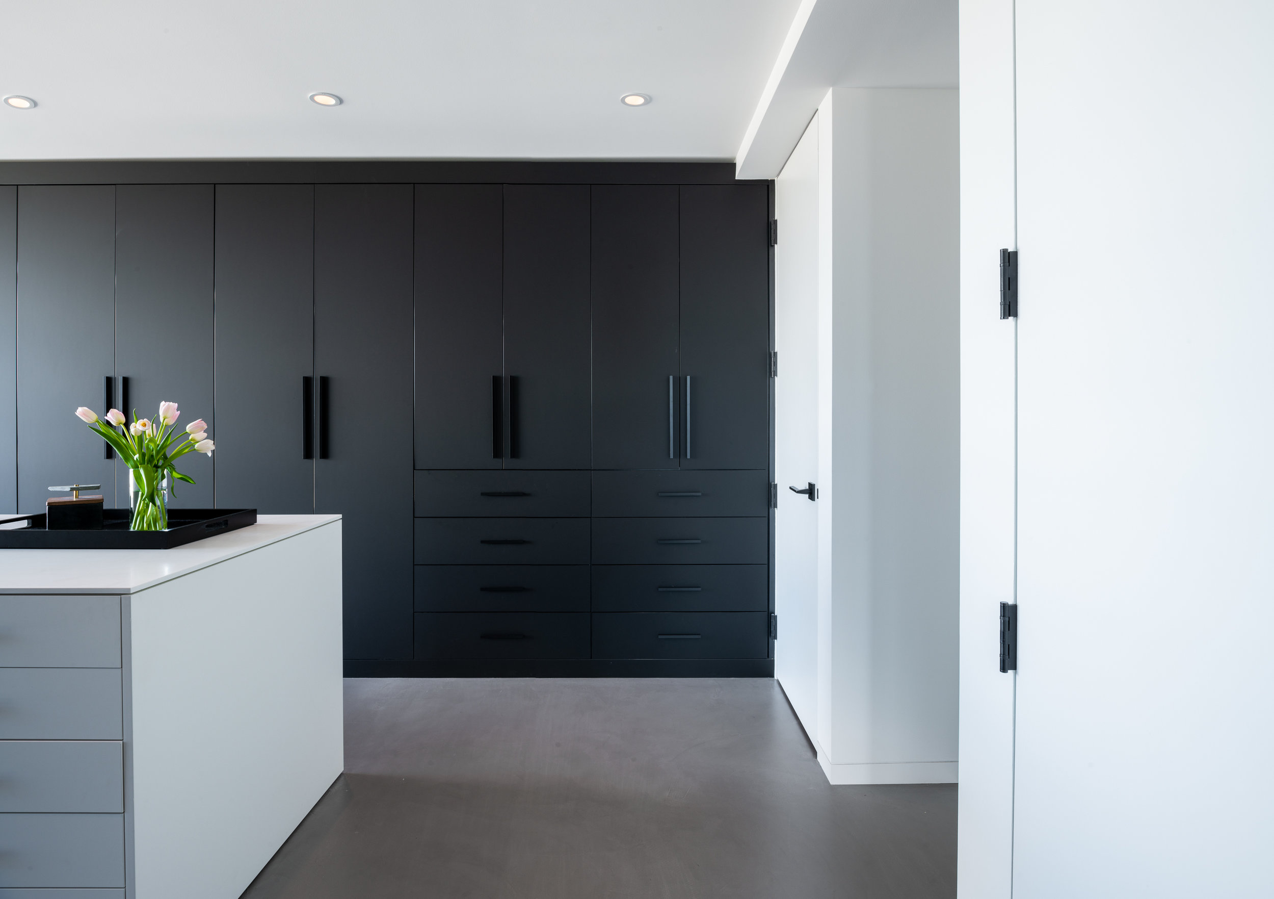 Modern monochrome custom closet cabinetry