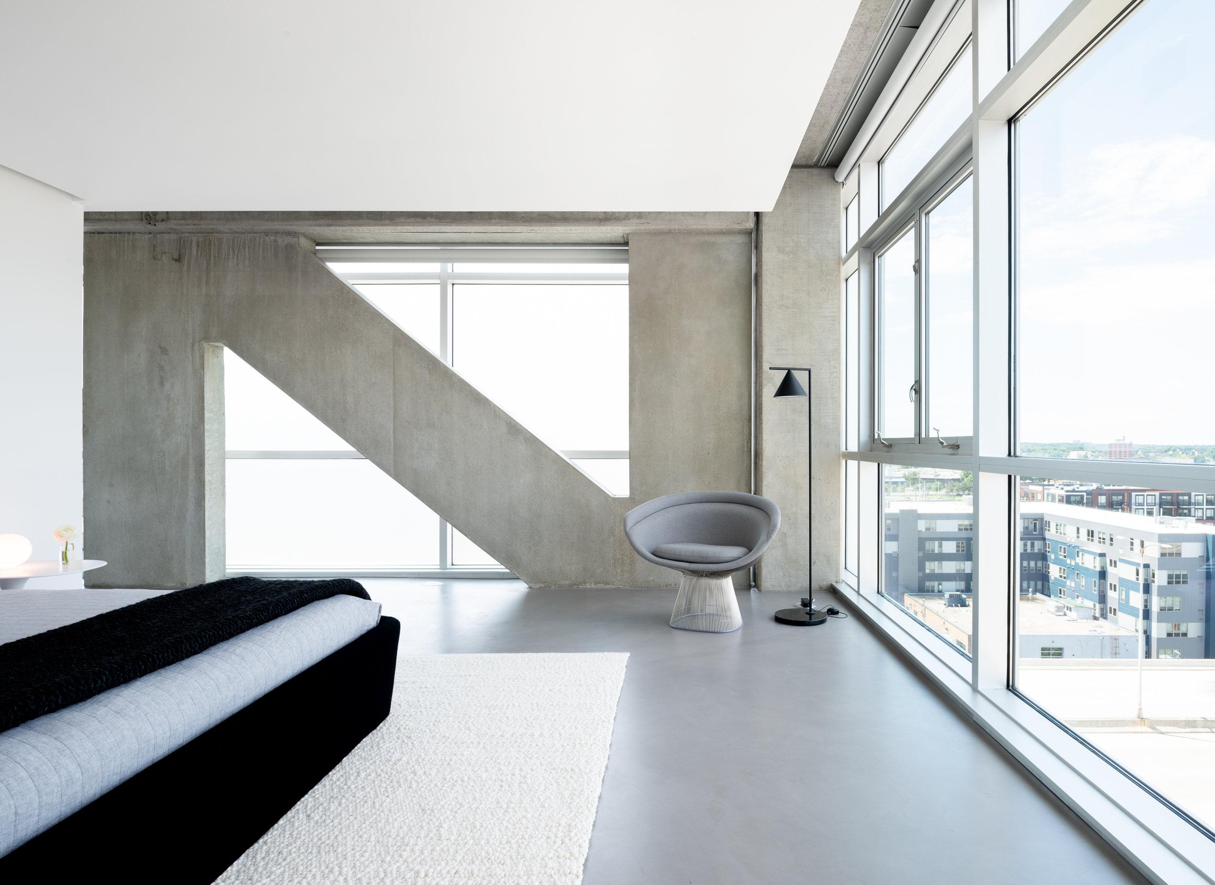 Modern monochrome bedroom with reading corner