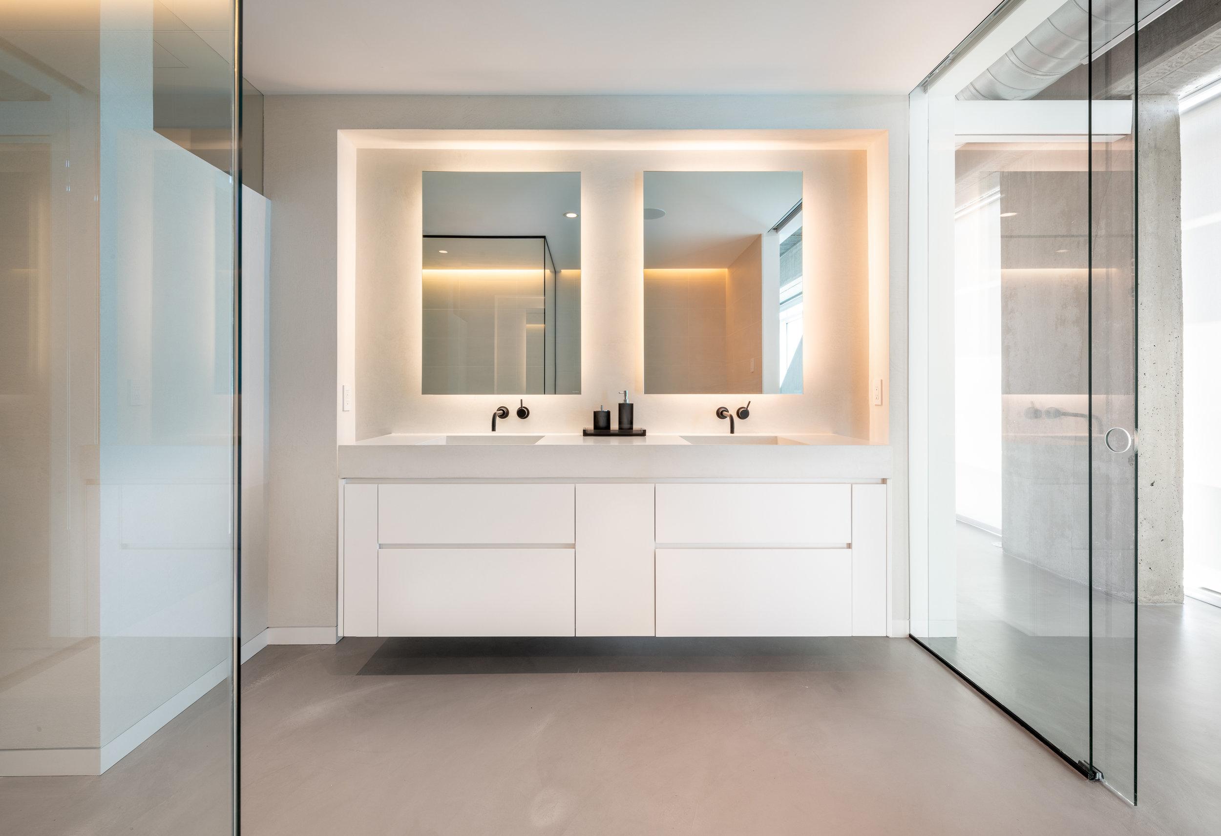 Custom floating bathroom vanity with light cove detail