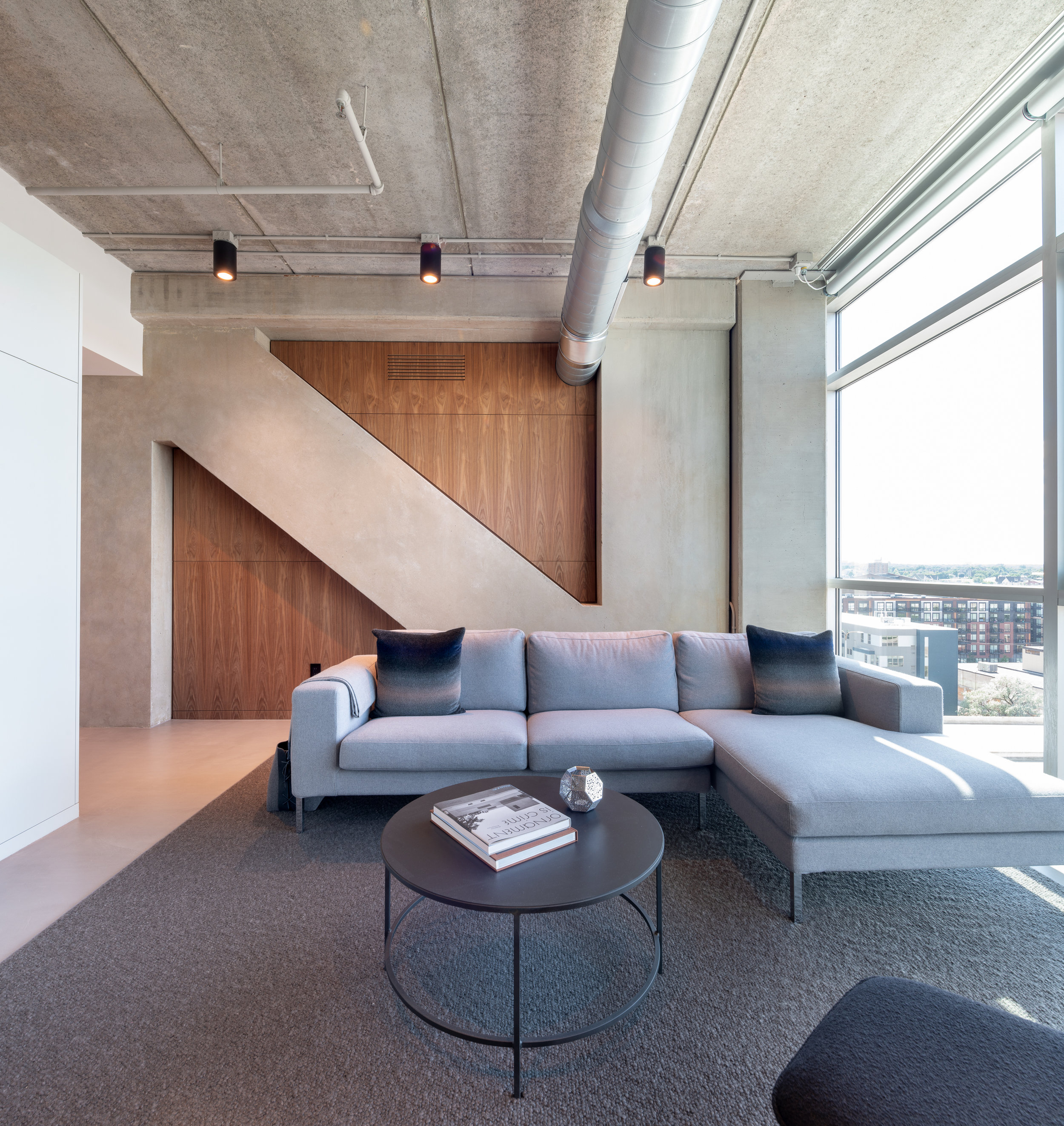 Modern den custom fitted wood panels designed by Christian Dean Architecture