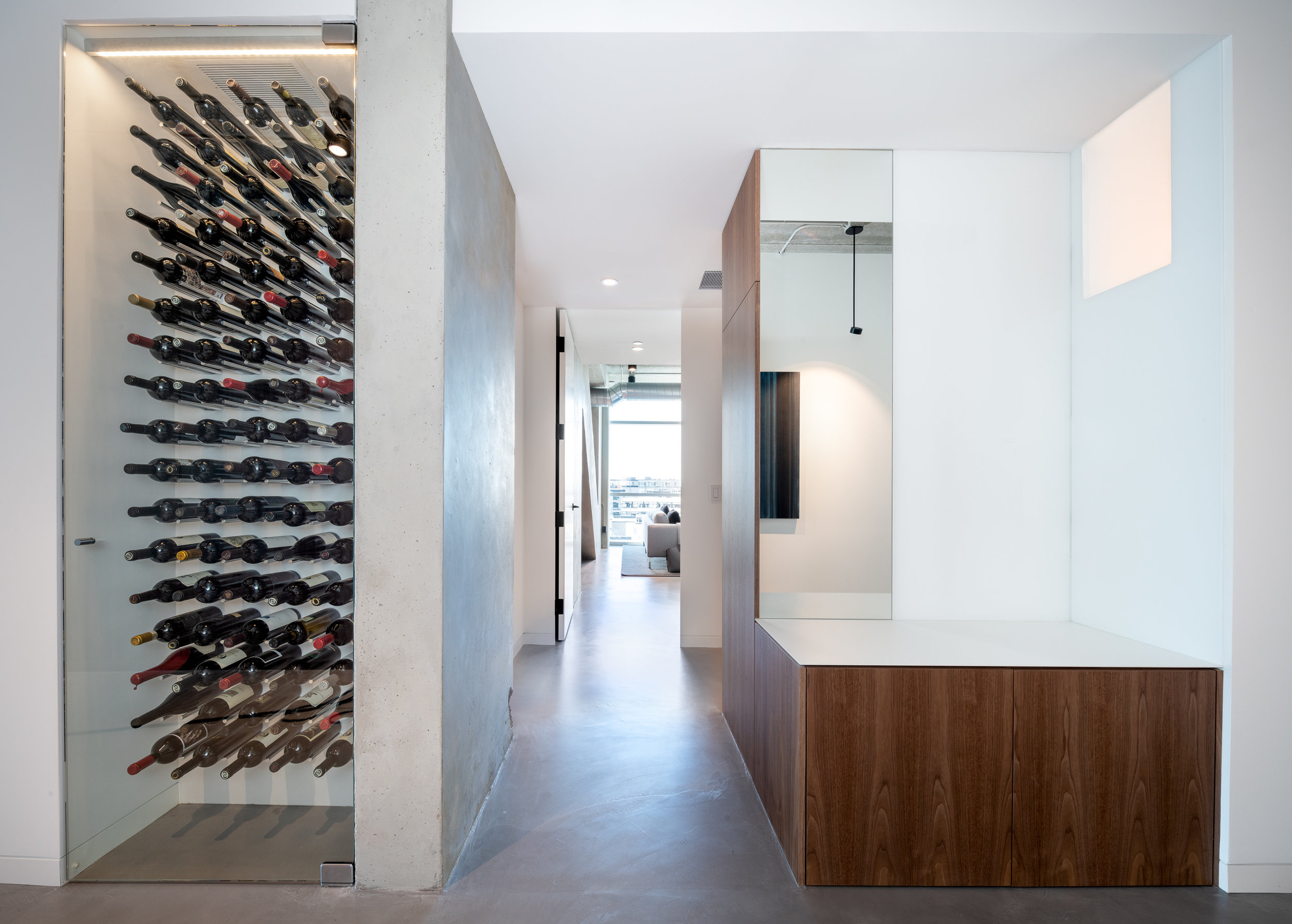 Custom wine storage and coat closet in loft foyer