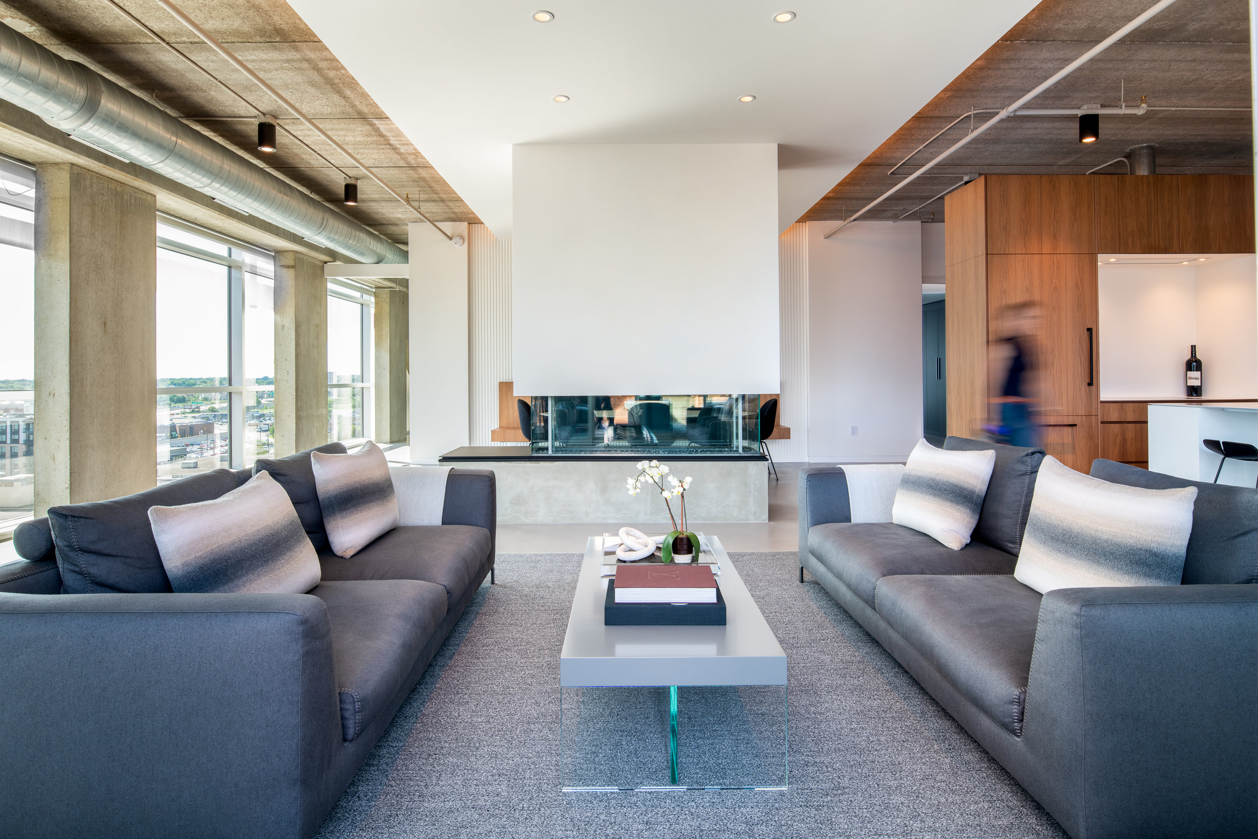 Modern living room with 360 fireplace and concrete hearth