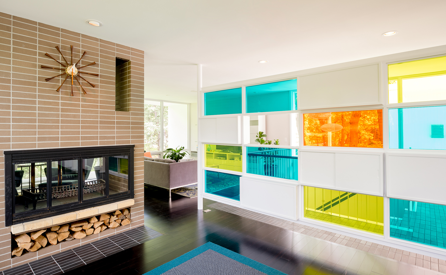 Midcentury brick fireplace and colorful divider wall