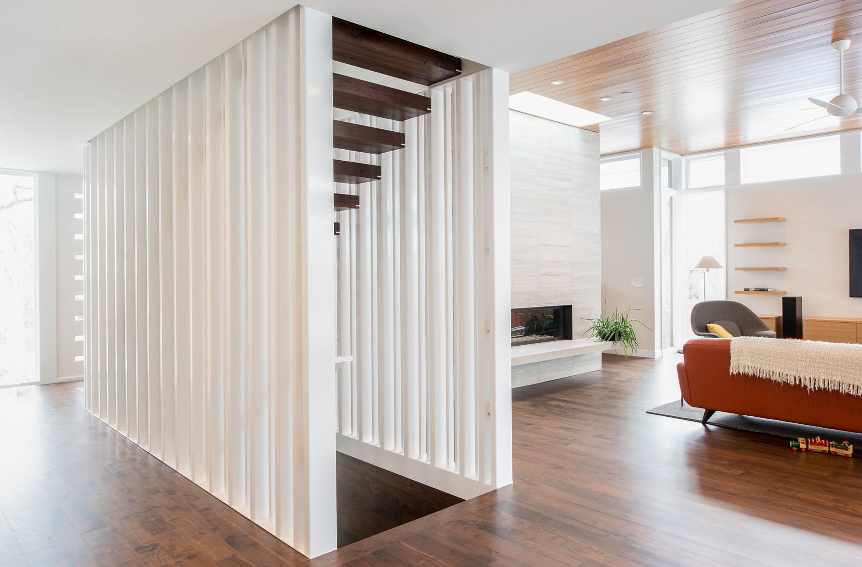Custom floating tread stair with slat walls