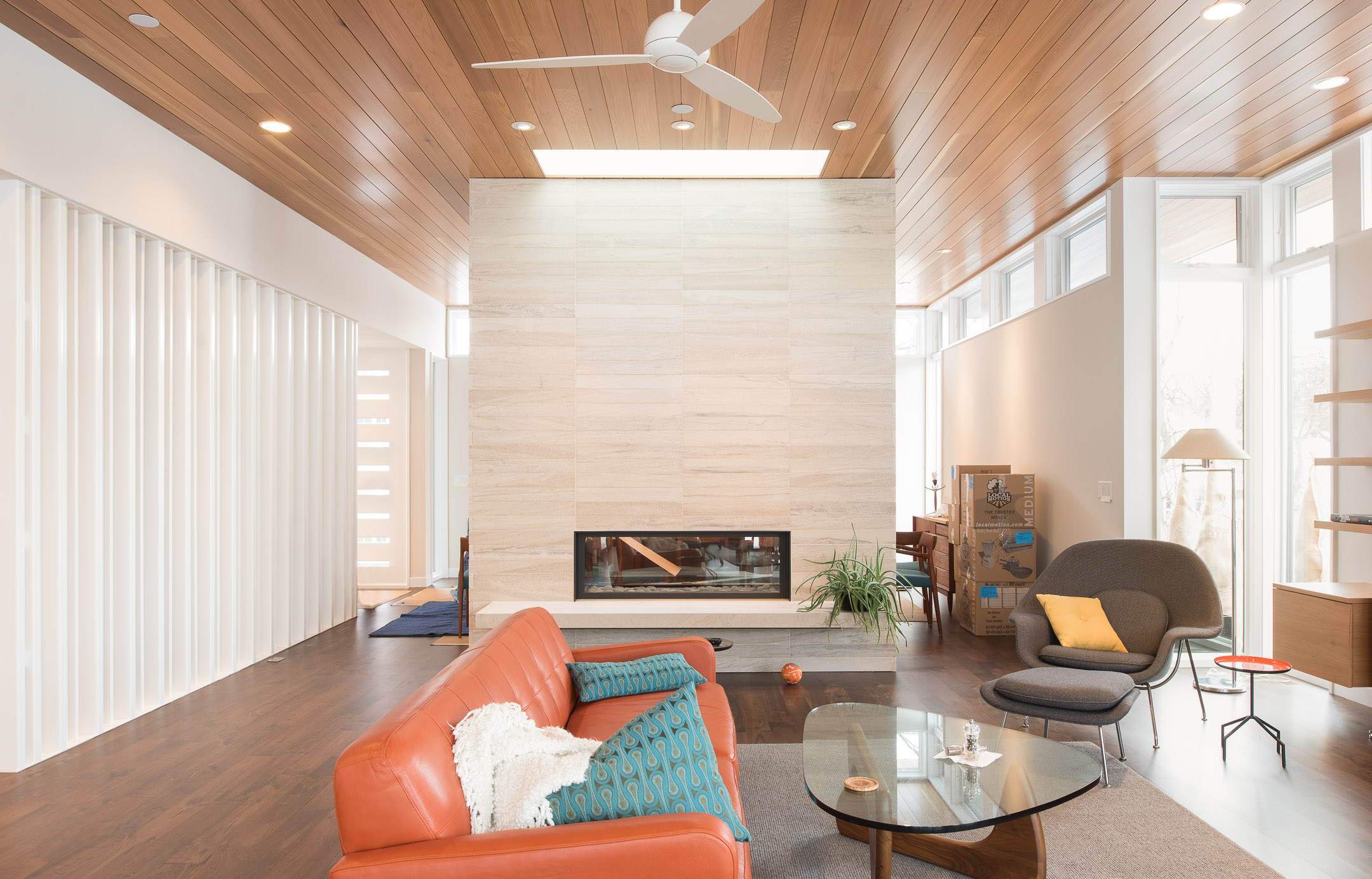 Modern living room with large dividing fireplace