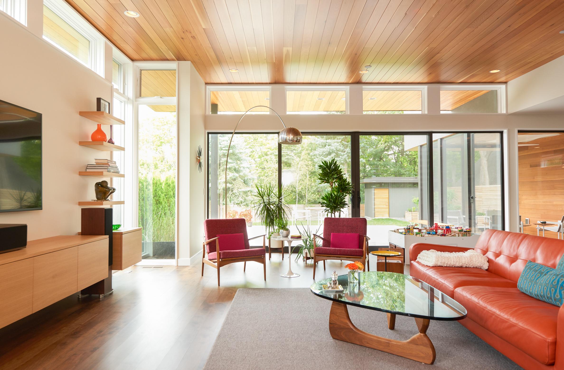Modern living room open to backyard