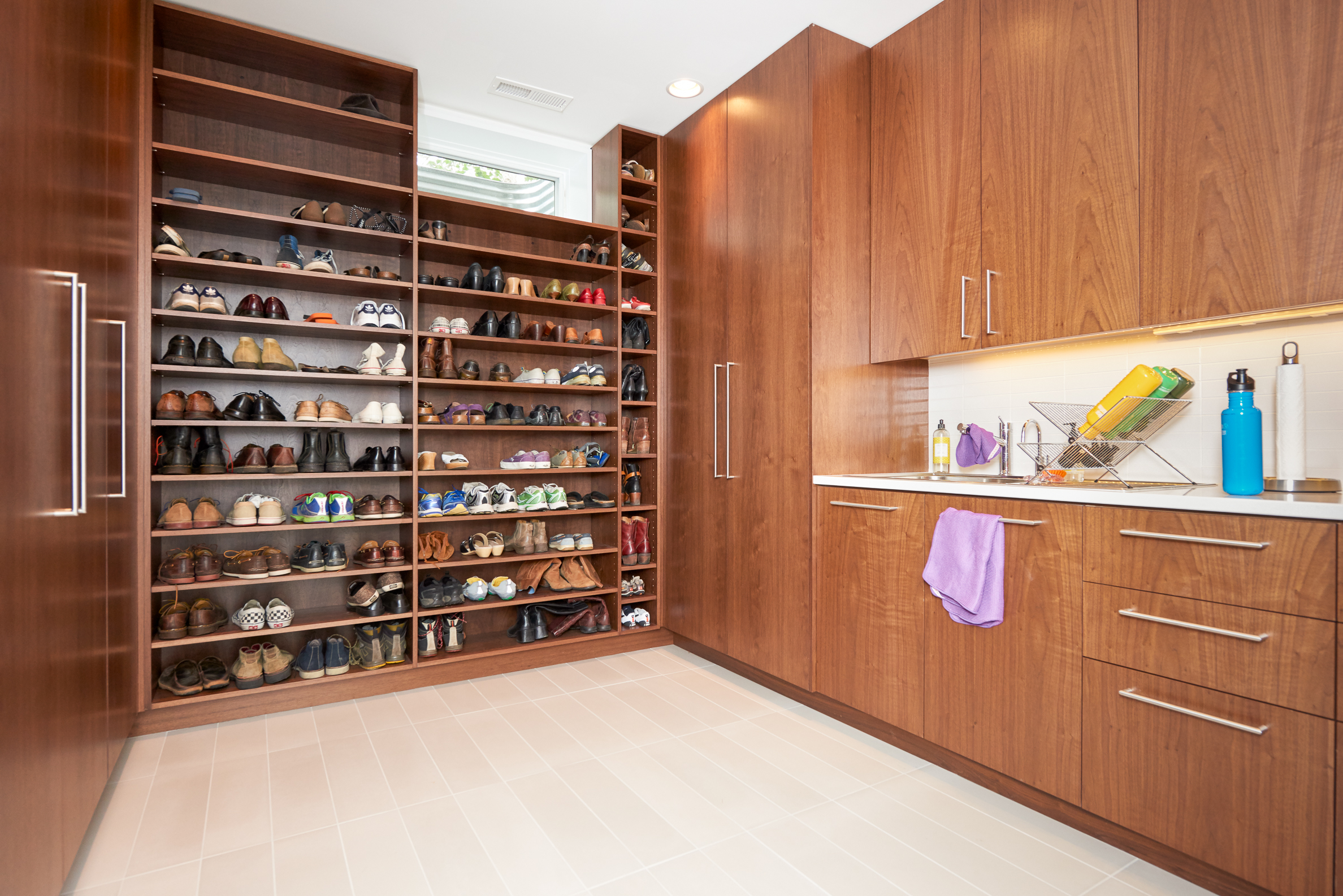 Custom shoe storage and mudroom cabinetry designed by Christian Dean Architecture