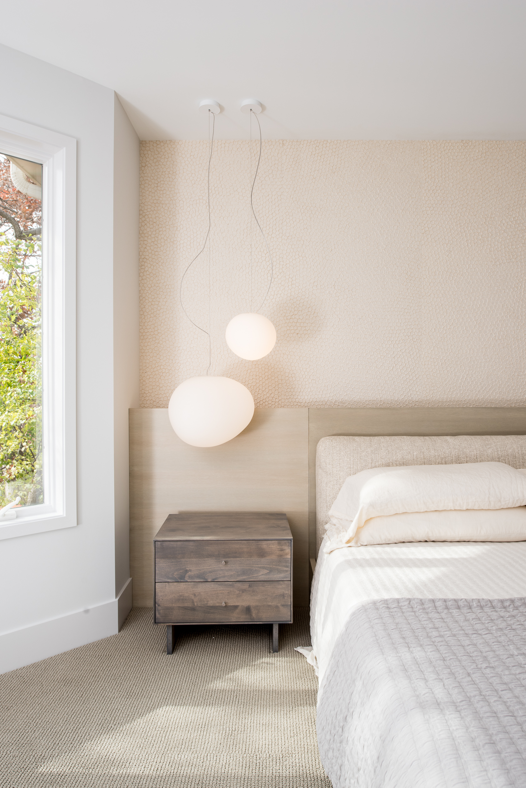 Master bedroom pendant and nightstand detail