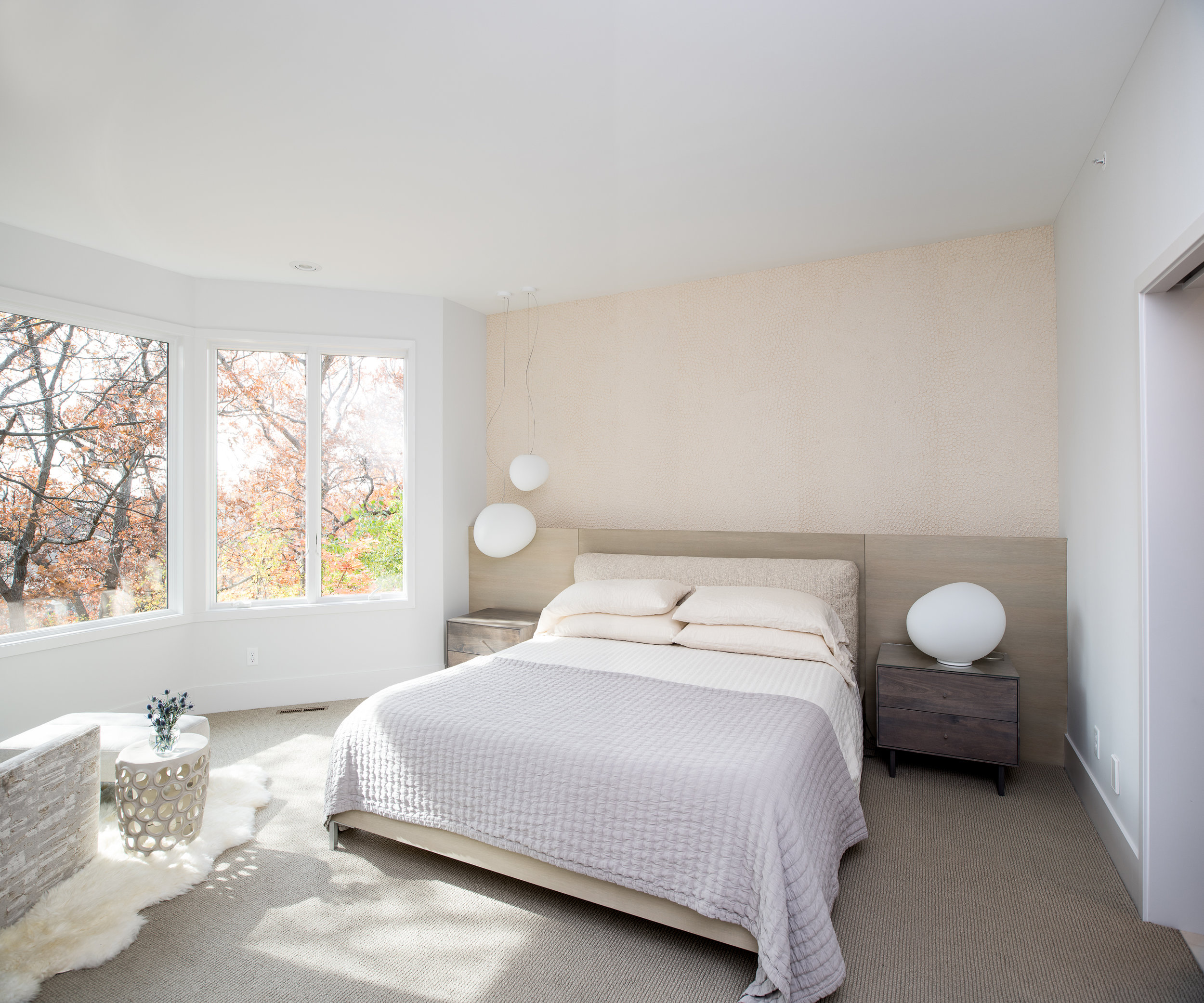 Modern master bedroom with pendants and minimal wallpaper