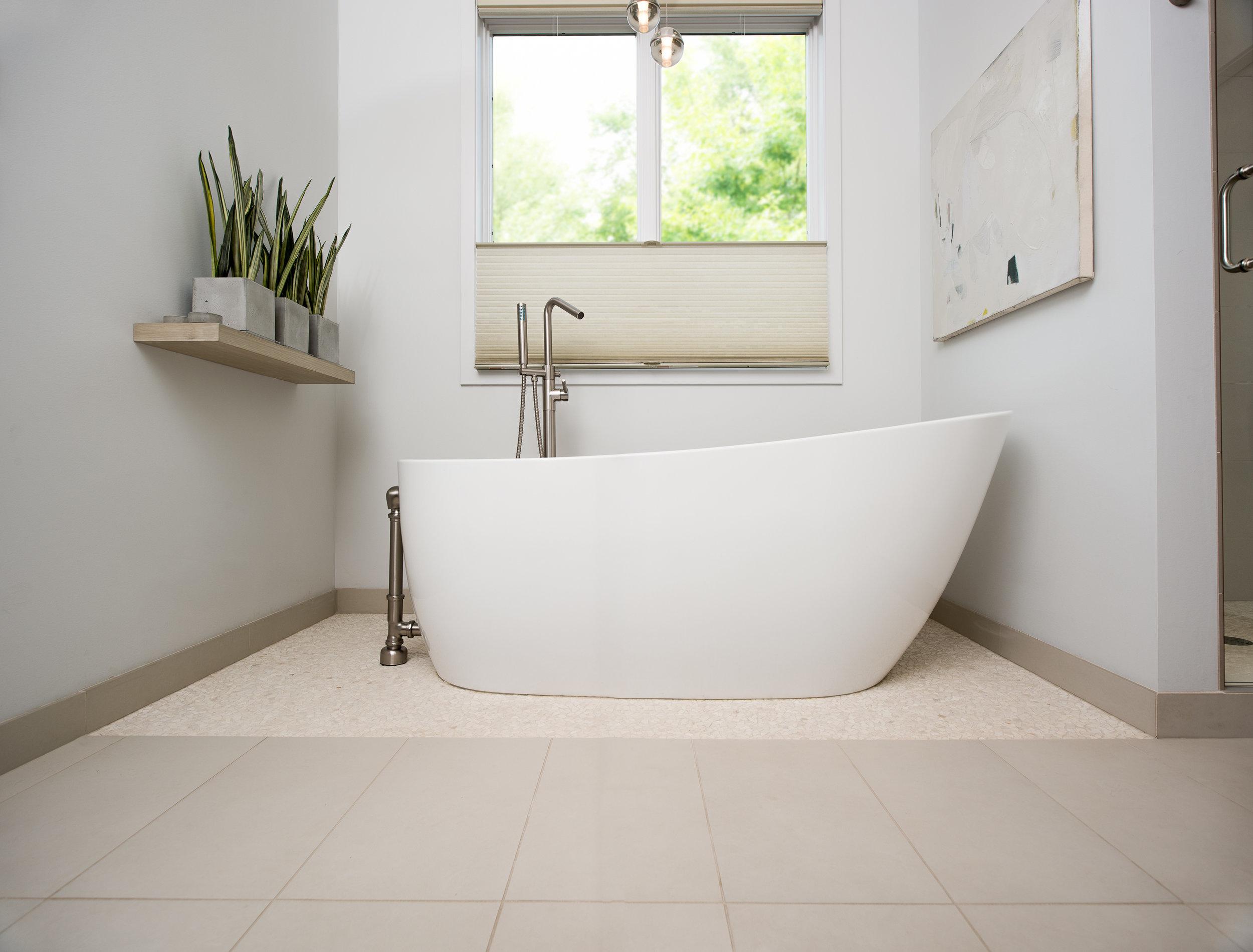 Floating tub in modern master bathroom