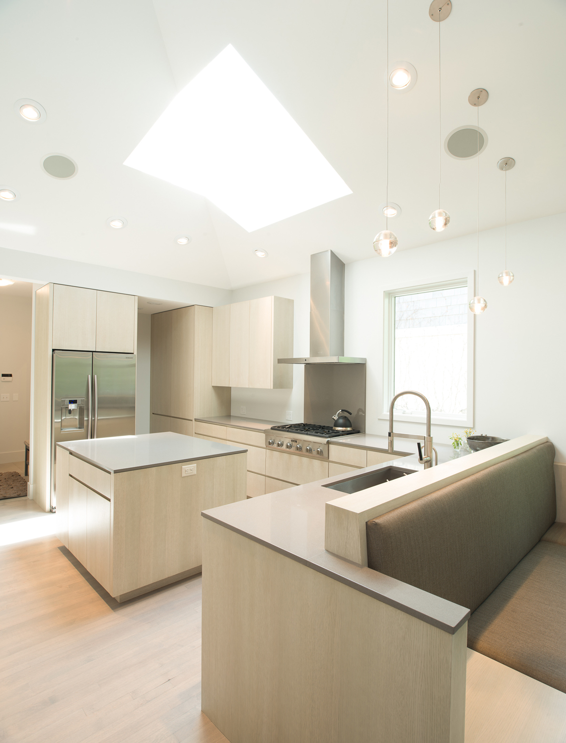 Modern minimal kitchen renovation with custom cabinetry and bench details