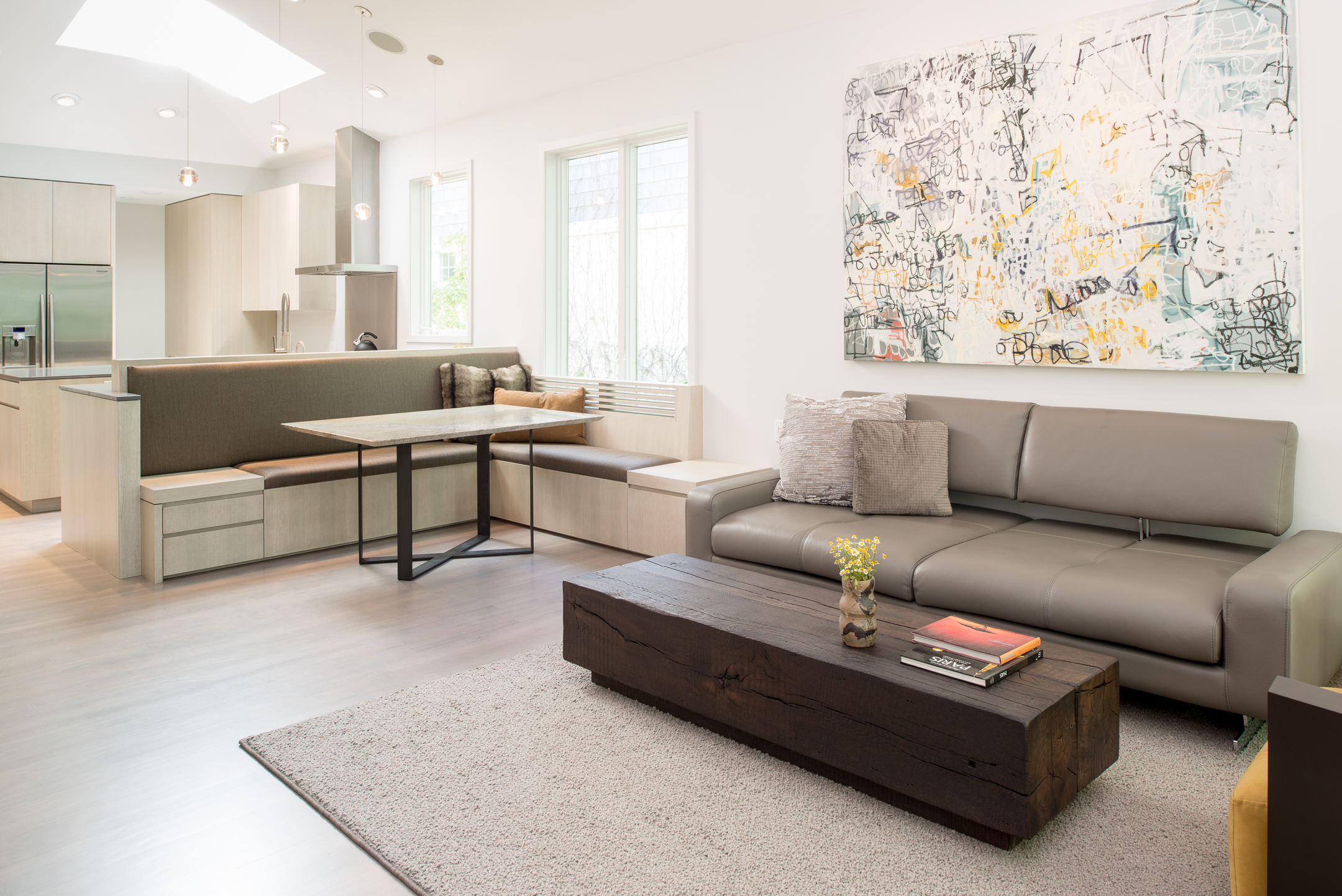 Modern living room open to kitchen and dining space