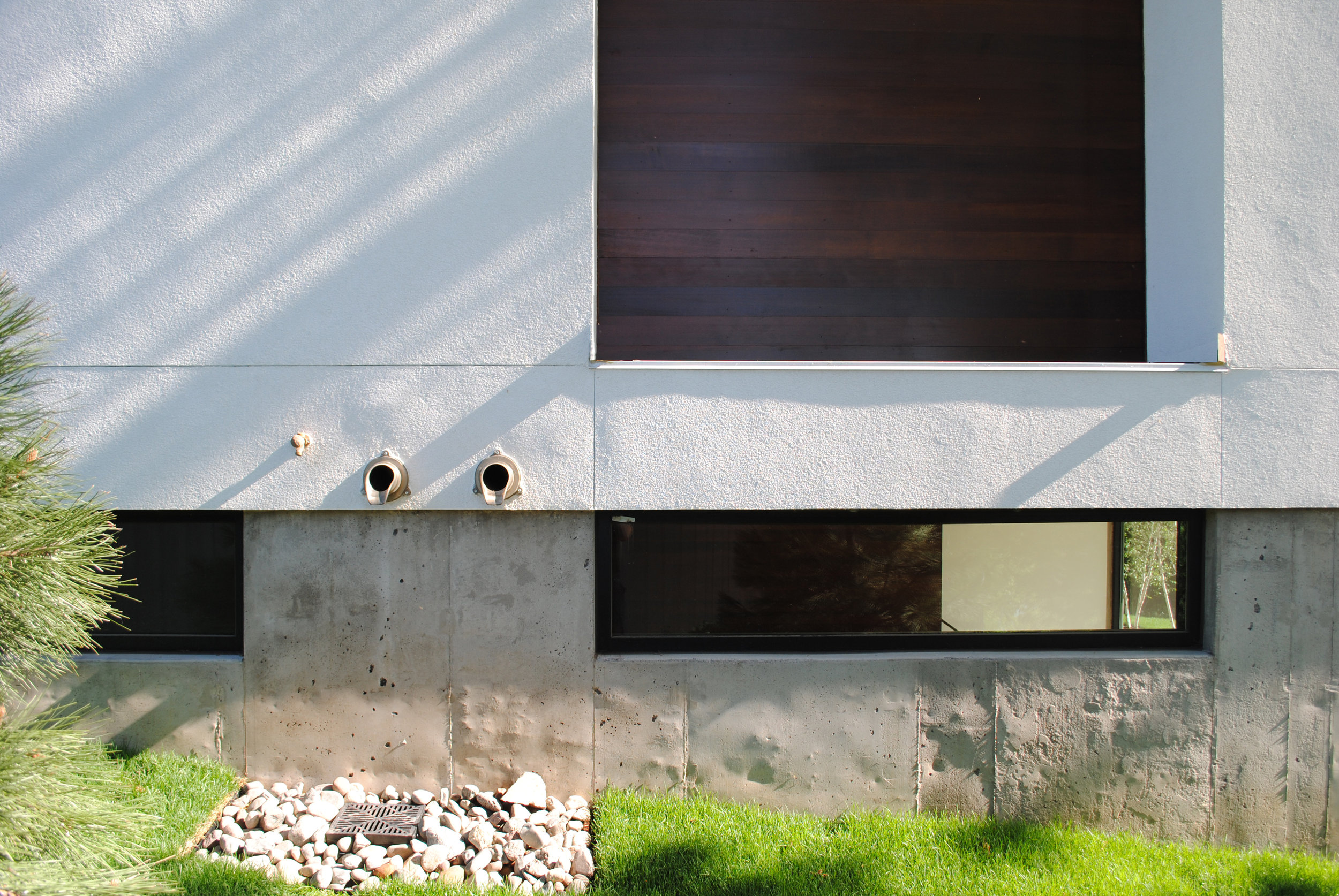 Cement, stucco, and wood exterior cladding detail