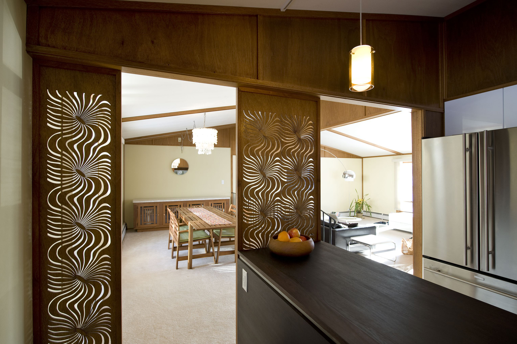 Graphic wood panel dividers into living area