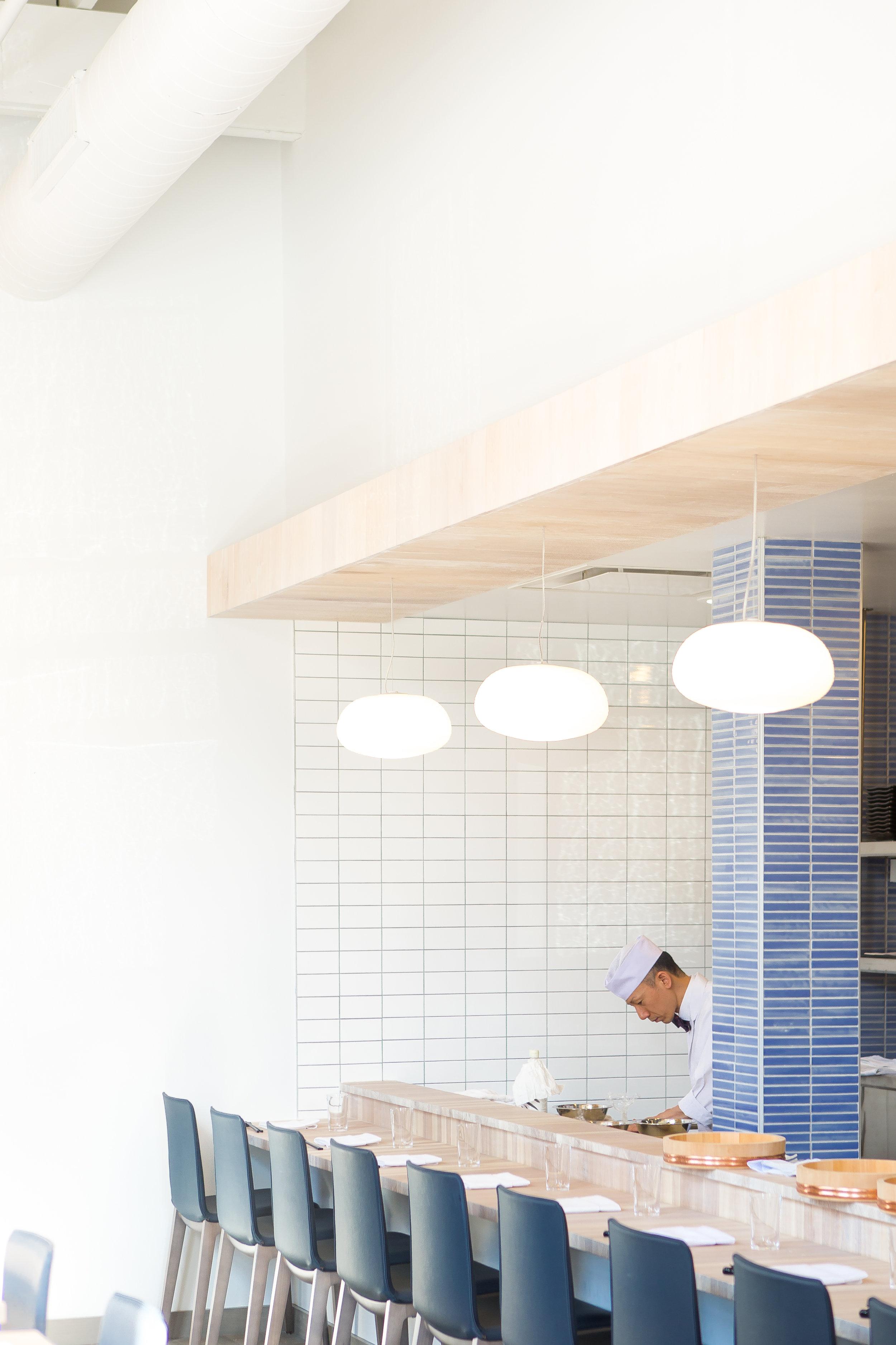custom wood bar and wood ceiling in modern japanese restaurant