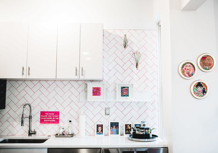 modern kitchen remodel with white herringbone tile layout and pink grout