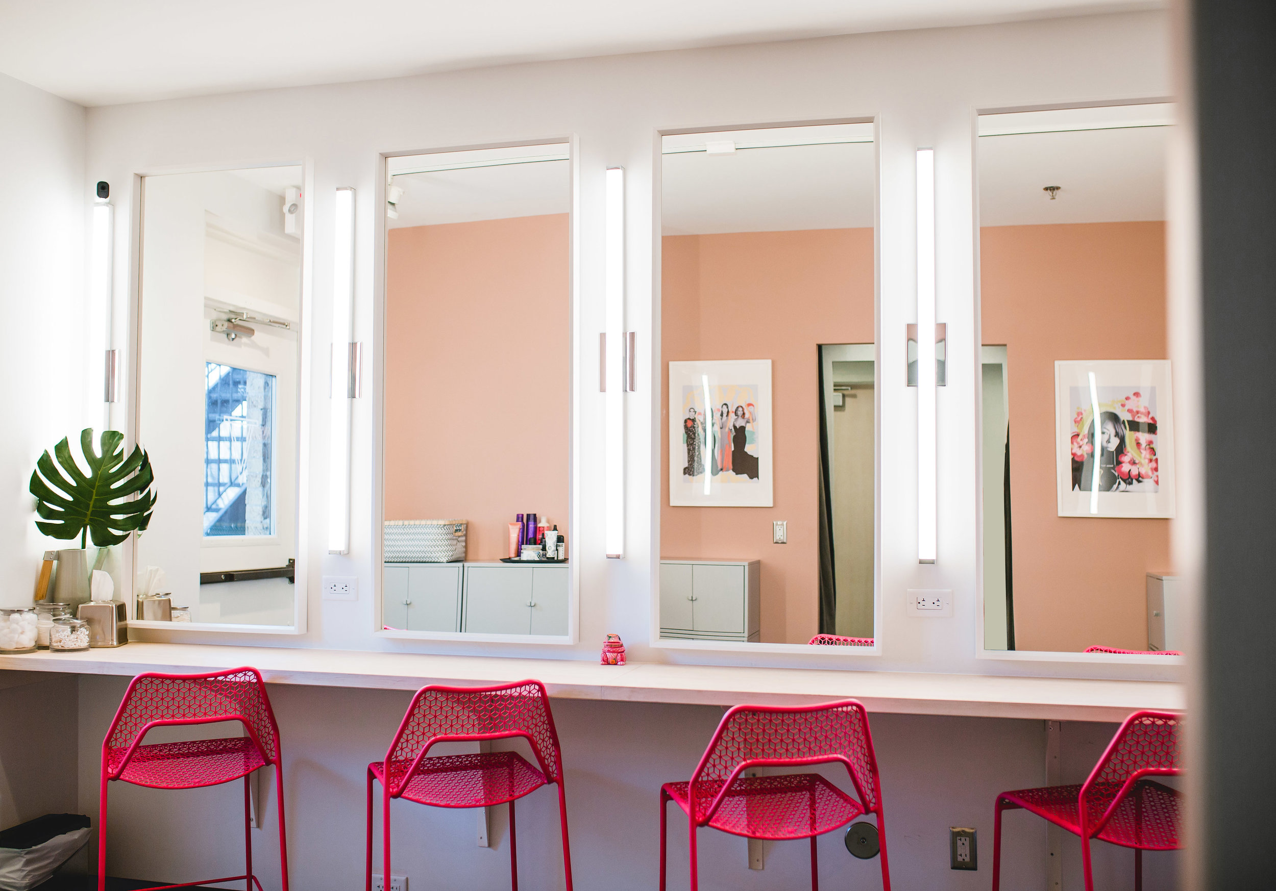 modern co-working space dressing room with hot pink blu-dot chairs