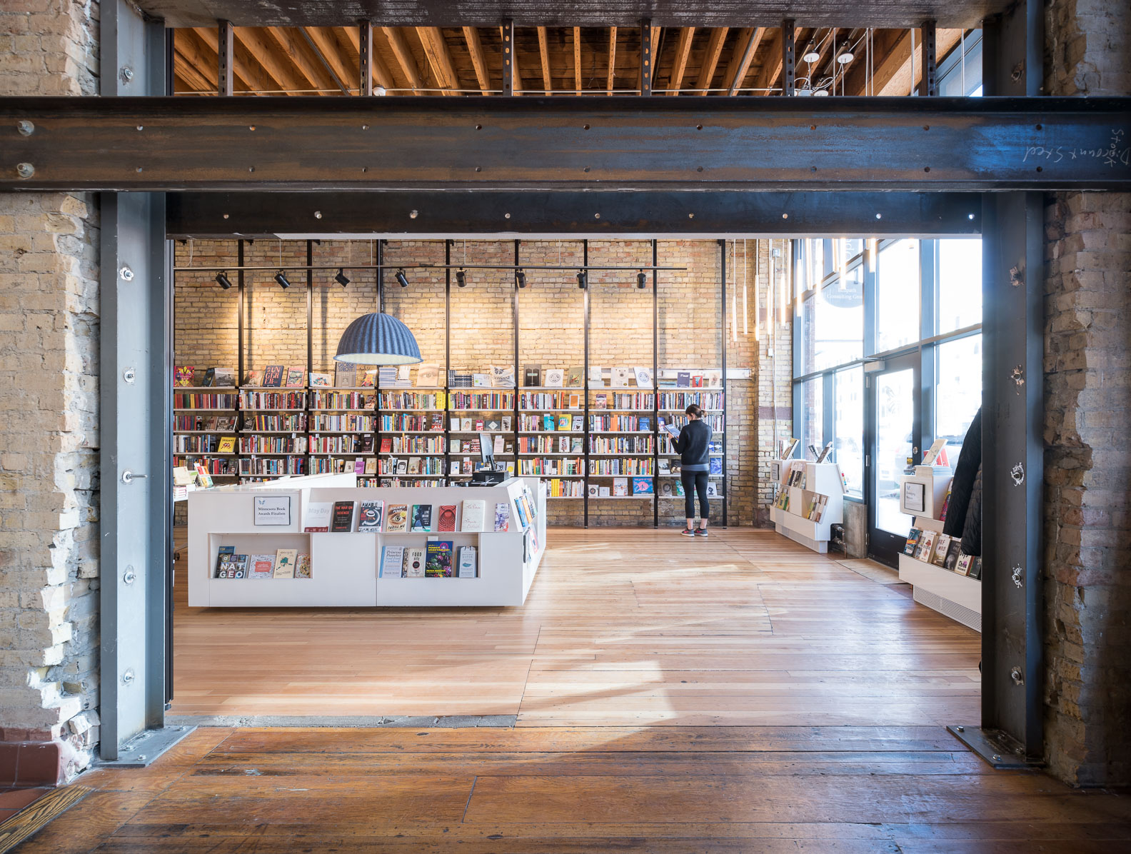 modern bookstore remodel in historic building with exposed structure by christian dean architecture in minneapolis