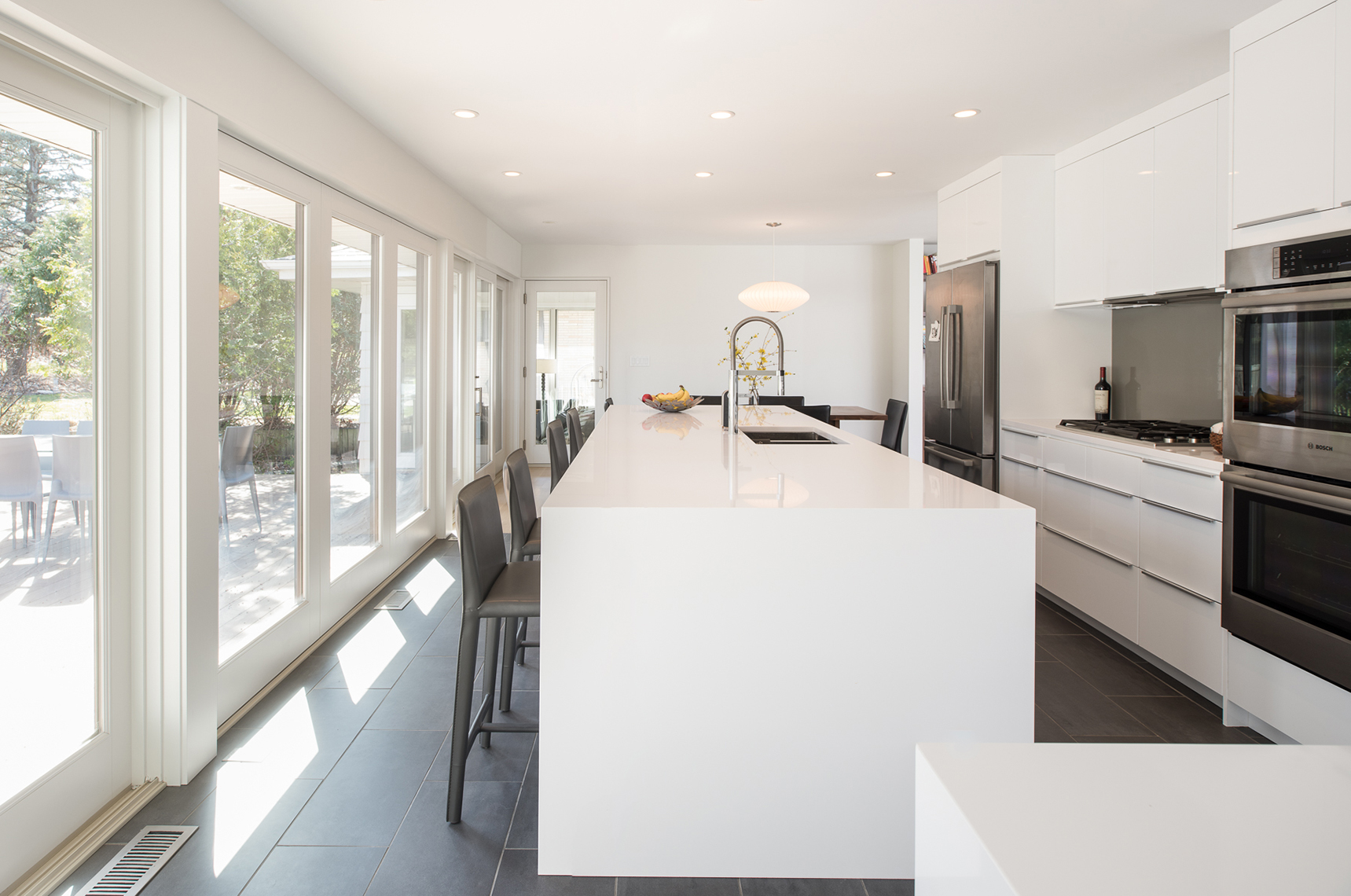 Modern white kitchen renovation in St. Paul, Minnesota by Christian Dean Architecture