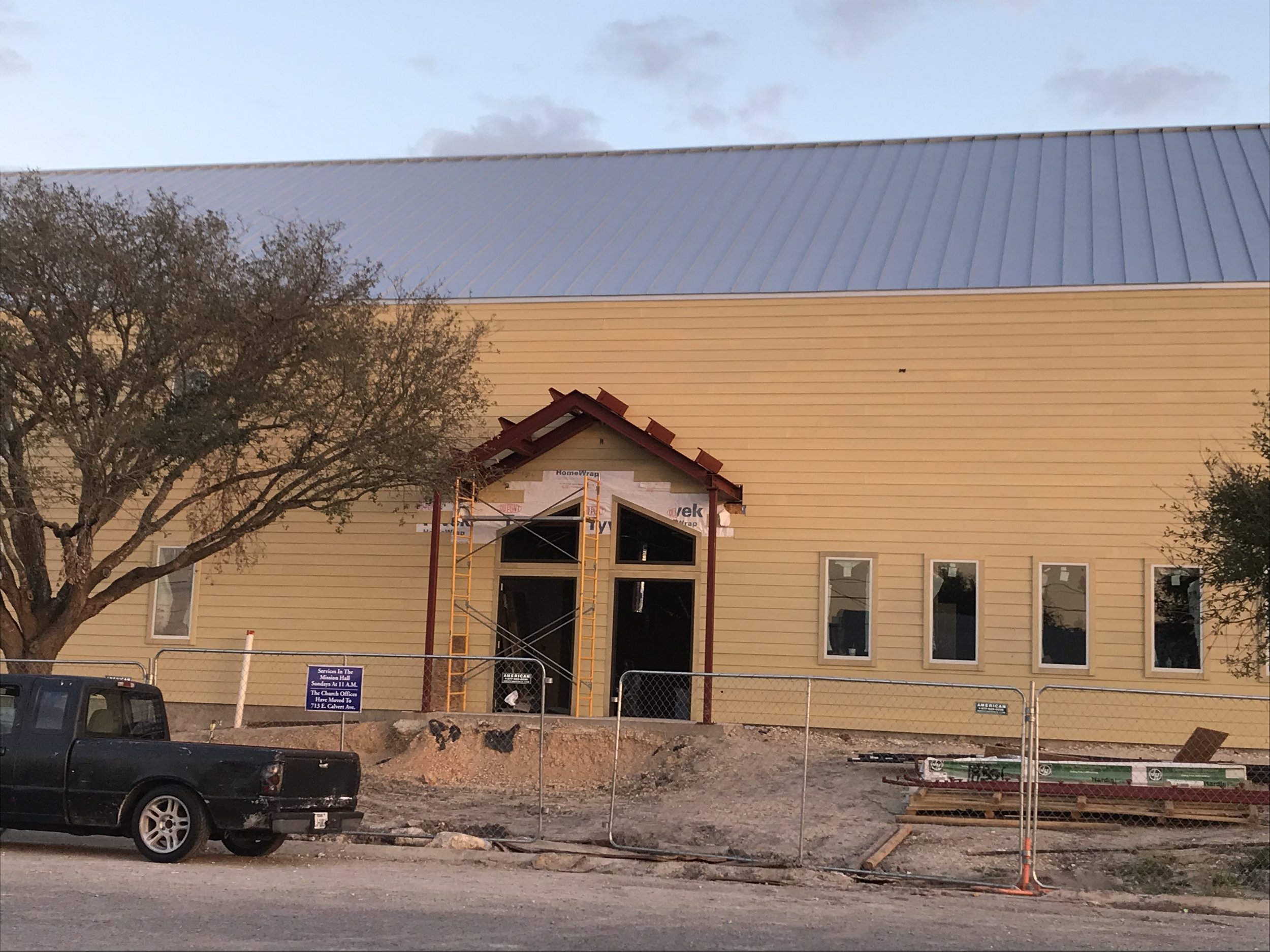 Almost all of the siding is up, and the awning frameworks for the entrances are in place!