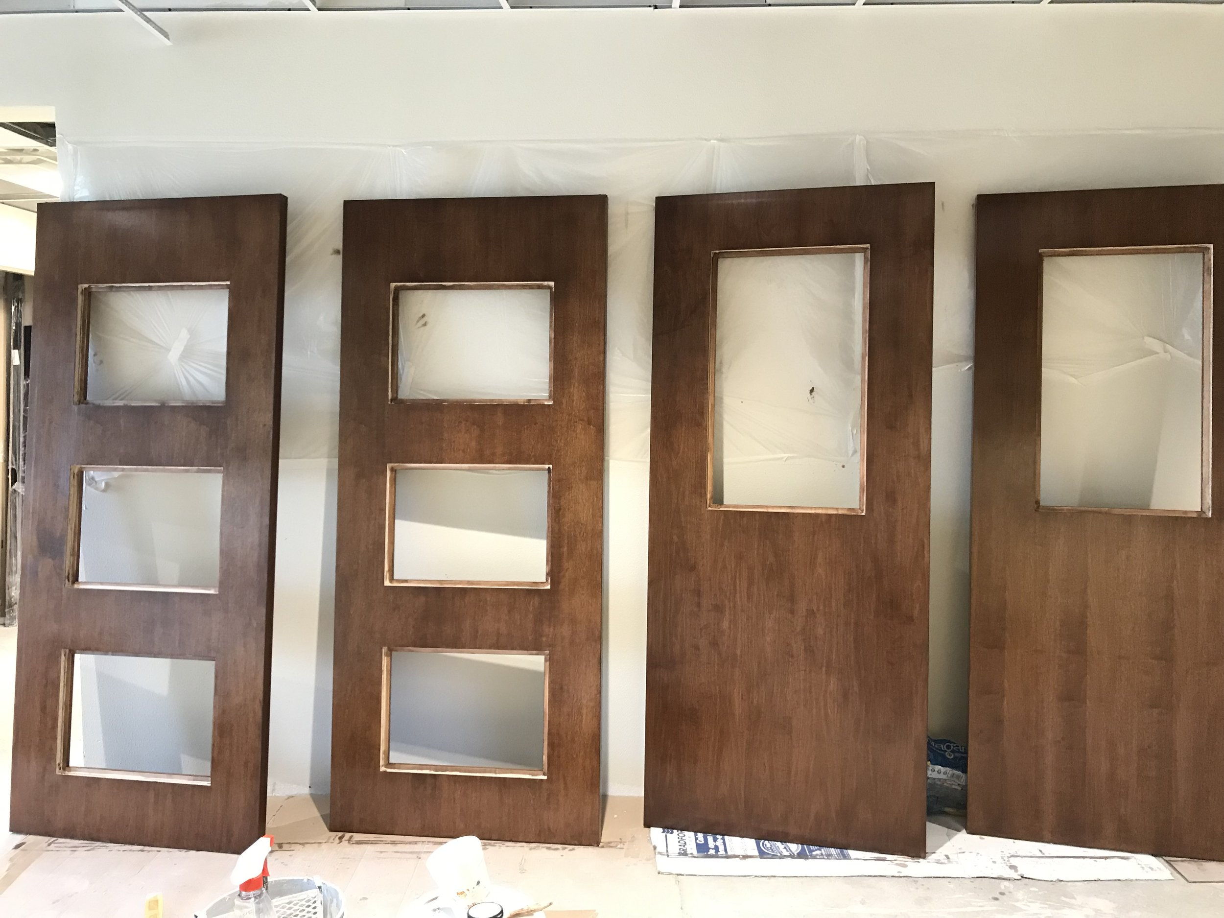 Interior doors for the sanctuary are stained. (I believe the doors with 3 glass pieces will be for the center aisle, and the ones with a single piece will be for the side aisles).