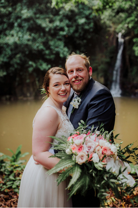 couple portraits with waterfall.PNG