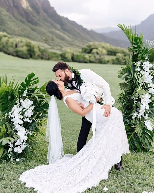 Swooning! This photo melts our hearts. We love this super classy look with the clean white orchids against the bold green monsters leaves. Is Modern Tropical your wedding style?