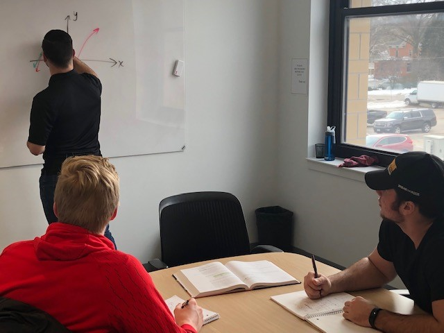 Tutor at white board with 2 male students.jpg