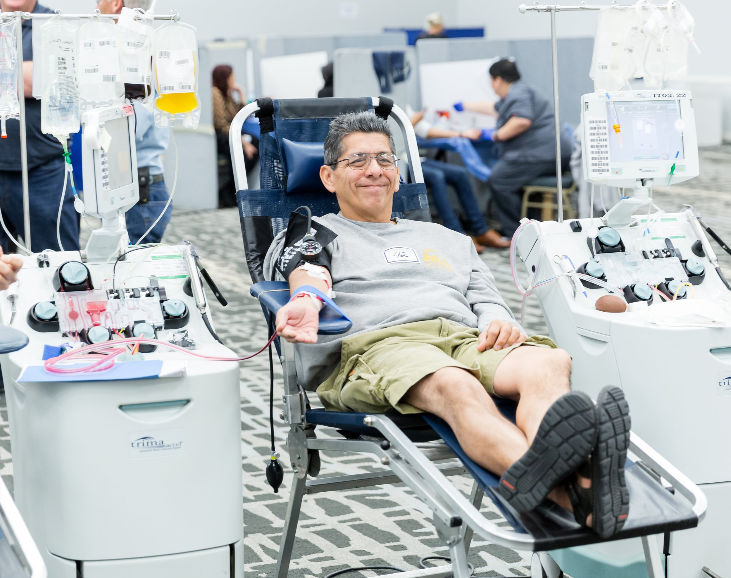 A blood donor volunteered at a mobile blood drive for plasma donation (plasmapheresis) which takes about 20 minutes to complete. The trima machine collects whole blood, separates red blood cells and plasma, and then the remaining blood components are returned to the donor. Currently, SDBB is looking to replace 14 trima machines for our donor centers and mobile drives. Make your gift today!