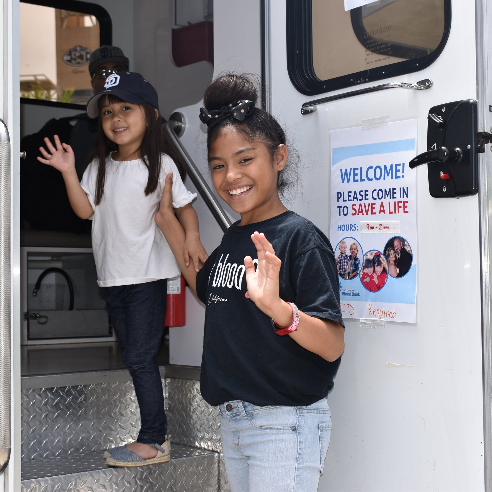 Kamila and Ella board a Bloodmobile full of smiles and gratitude.