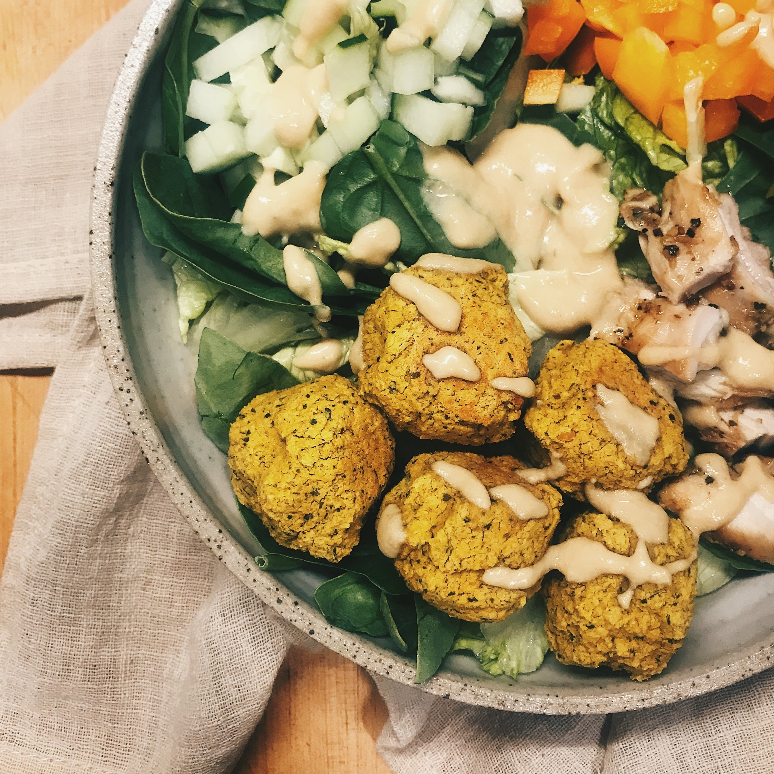 Falafel Balls with Tahini Sauce by TheCupboardSF   So tasty in a coconut wrap or as a salad! Add your favorite protein if you prefer! Enjoy!    Recipe Here   !