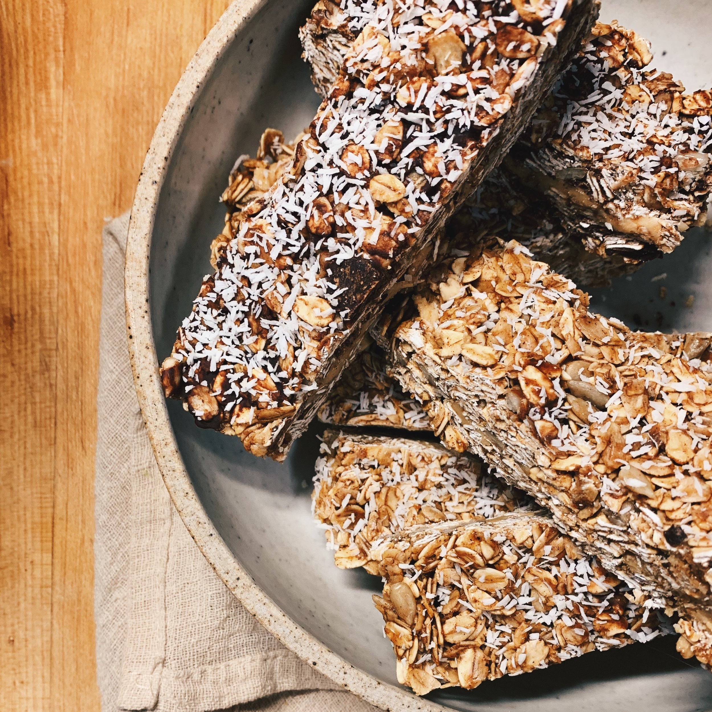 Homemade Granola Bars   These were easy and are a HIT in the house right now! I made a few adjustments:  - Excluded chocolate chips from one (Used Enjoy Life)  - Removed some of the Coconut Sugar (The Maple Syrup was enough sweetness for us) - Added a middle layer of Peanut Butter  - Added Sunflower seeds - Baked the oats for a bit longer for extra toasty-ness and crunch - Removed Chocolate Drizzle and sprinkled shredded coconut instead on top   Recipe    Here   !