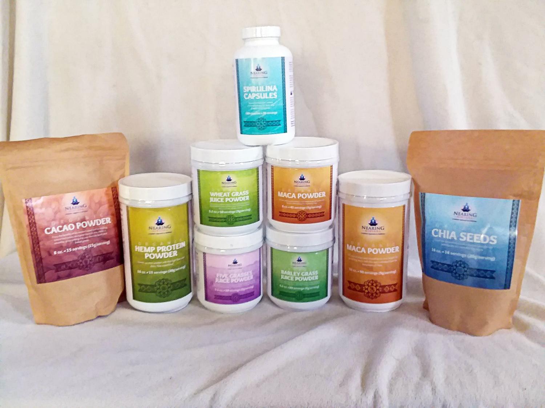 Nearing Nirvana Superfoods, including 8 SKUs of Hemp Powder, Cacao Powder, Chia Seeds, Spirulina, Wheat Grass, Maca, Five Grasses, and Barley Grass.