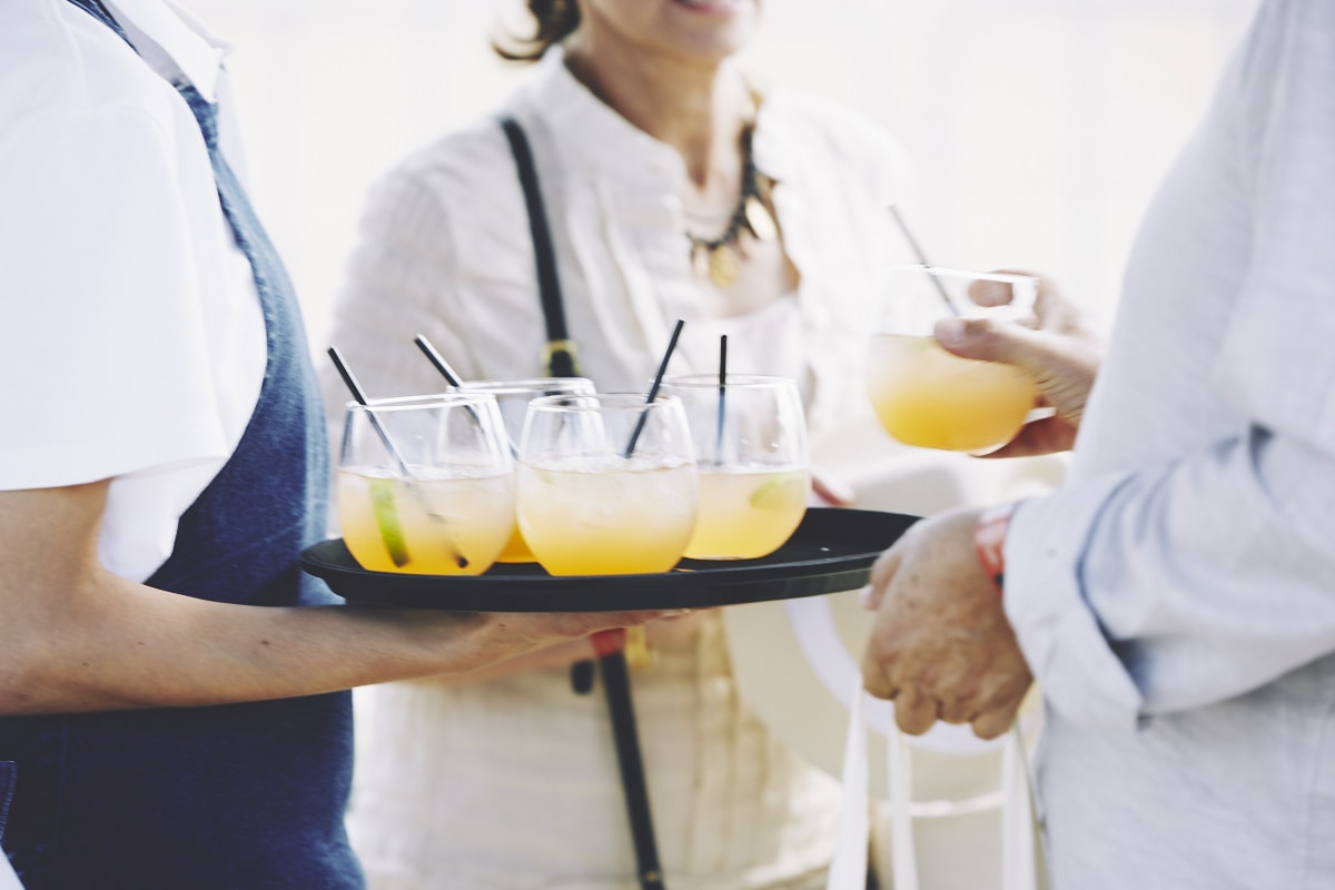 Our staff serving a delicious summer cocktail at an event.