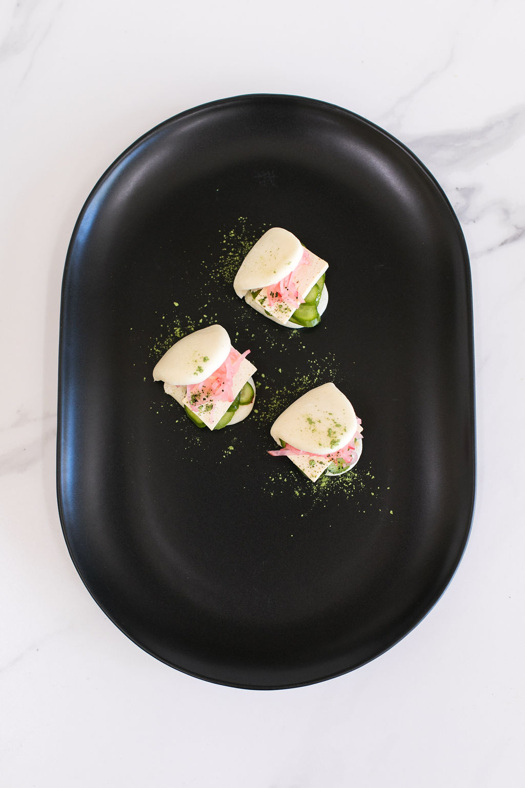 C - Steamed bao bun filled with smoked tofu, chili sauce, pickled cucumber and radish salad3.jpg