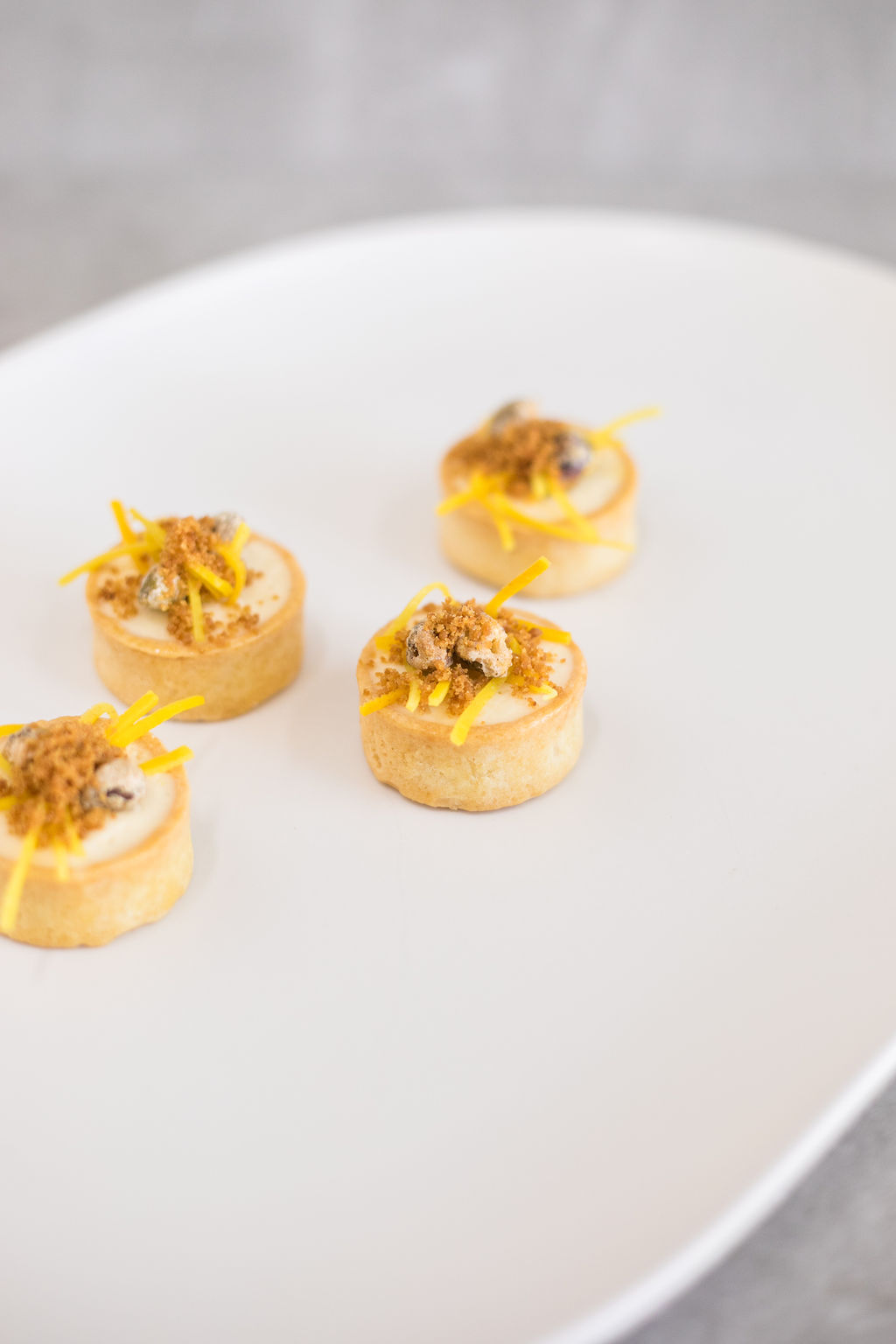 D - Zesty orange cheesecake tart, candied pistachio and ginger biscuit crumb6.jpg