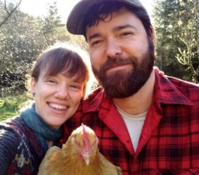 Erin, Sean, and one of their many chickens, Rosie.