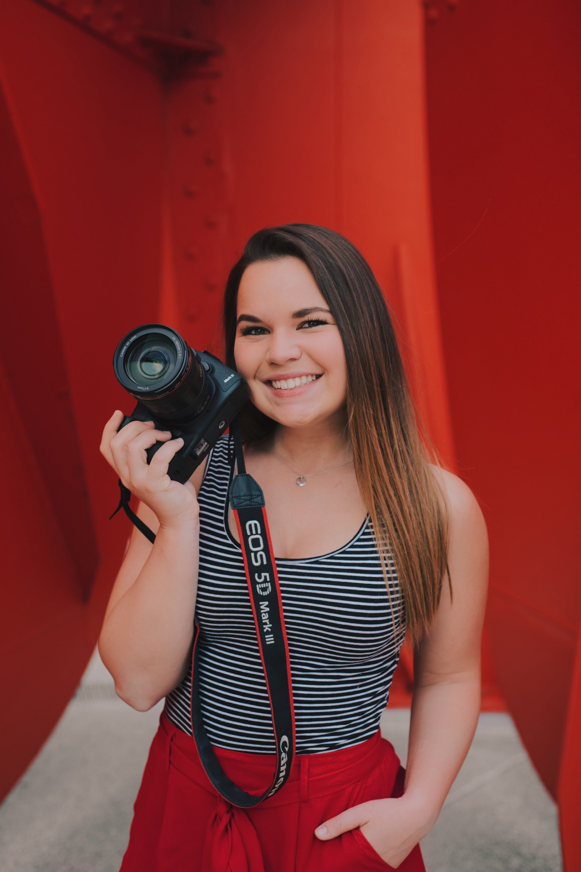 BIO - Thank you for visiting my photography site! I'm Valerie Wojciechowski (but Wojciechowski is intimidating…so you can just say Wojo.) I graduated from Grand Valley State University in 2019 with a Bachelors of Arts in Photography. I am currently a full time adjunct photographer for Grand Valley State University where I shoot for the Grand Valley Magazine and other University publications. I love ALL types of photography, which is why I have found my place as a photographer in higher education. Higher ed photography is a little bit of everything, it's a little bit of portraiture, it's a little bit of architecture, little bit of sports, little bit of editorial, little bit of photojournalism, little bit of marketing. I never get bored, and I always have the opportunity to challenge myself.West Michigan is my home. I have a cat, his name is Kathleen. If I had one wish, I'd ask for pizza and wine to have no calories. I love a good philosophical debate almost as much as I love to watch Fixer Upper. I'm that girl who gets way too excited to write events in her planner. Oh yeah, and photography… lots and lots of photography. Need to know more? Shoot me a message!